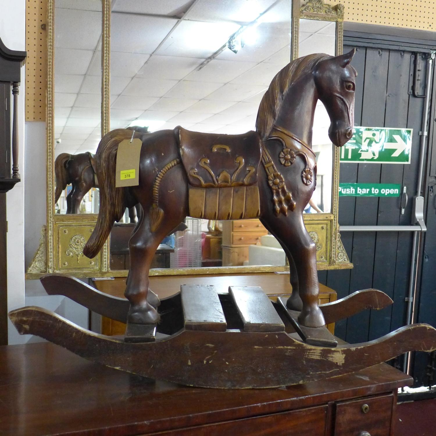 Lot 378 - A carved wooden rocking horse, H.69 W.100 D.36cm