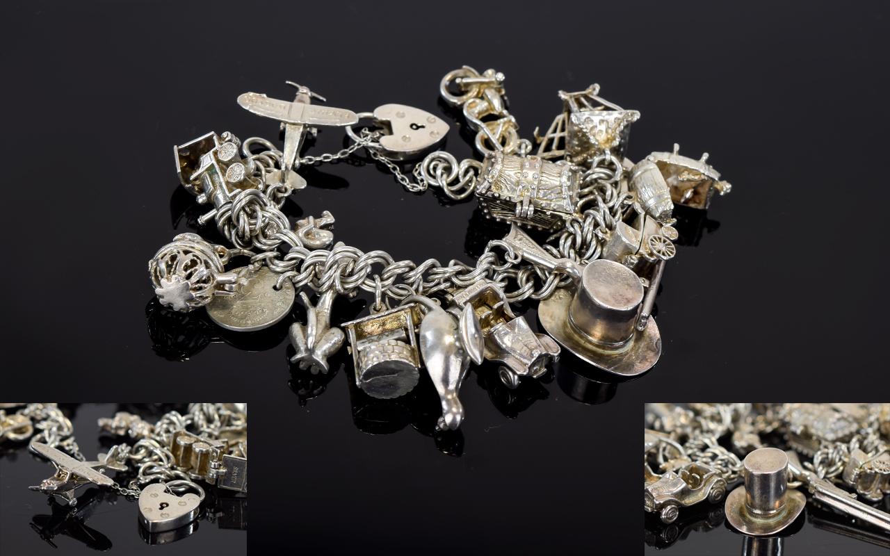Lot 61 - A Good Quality Silver Charm Bracelet Loa