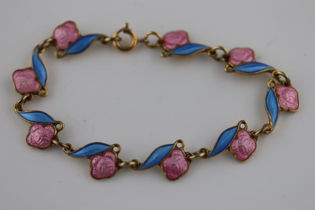 Lot 32 - Arne Nordlie, a Norwegian enamelled silver gilt child's bracelet, pink enamelled roses attached to