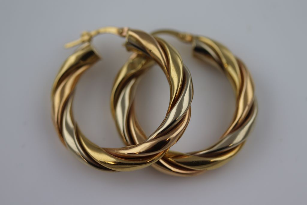 Lot 12 - A pair of unmarked gold twisted hoop earrings, subtle tri-colour gold finish, diameter