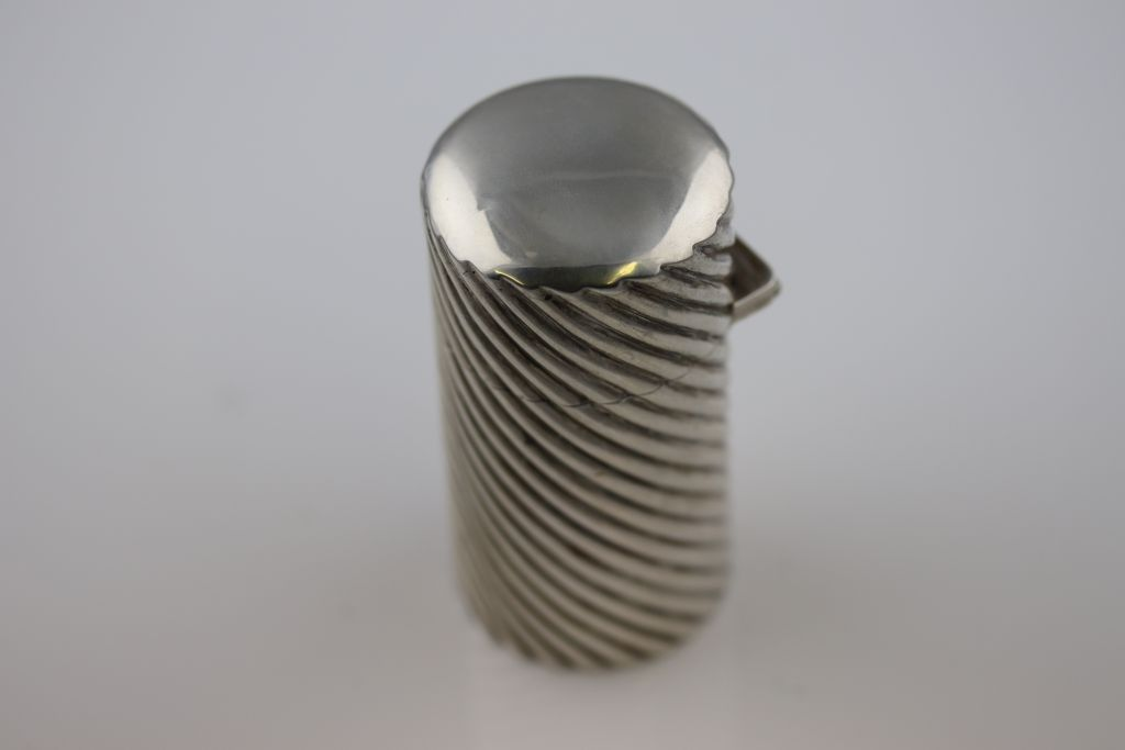 Lot 4 - A Victorian silver cylindrical scent bottle, London 1890 Sampson Mordan & Co, reeded writhen body