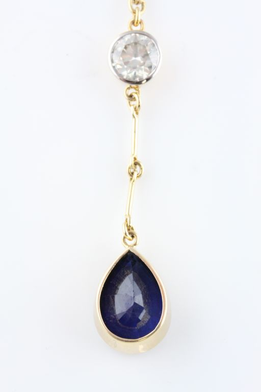Lot 55A - A diamond and blue sapphire 18ct yellow gold pendant necklace
