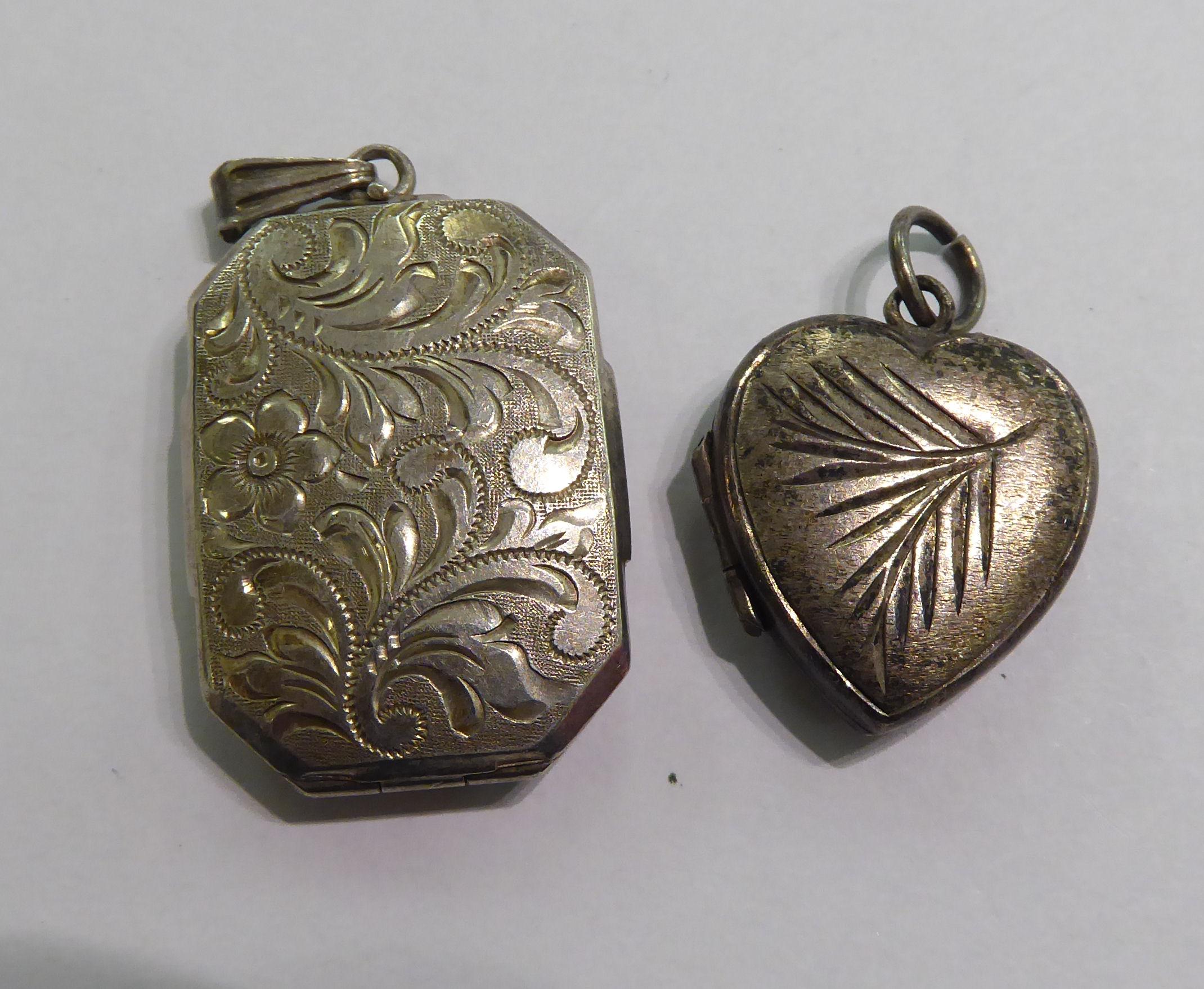 Lot 41 - Two similar 'antique' white metal pendant locks 11