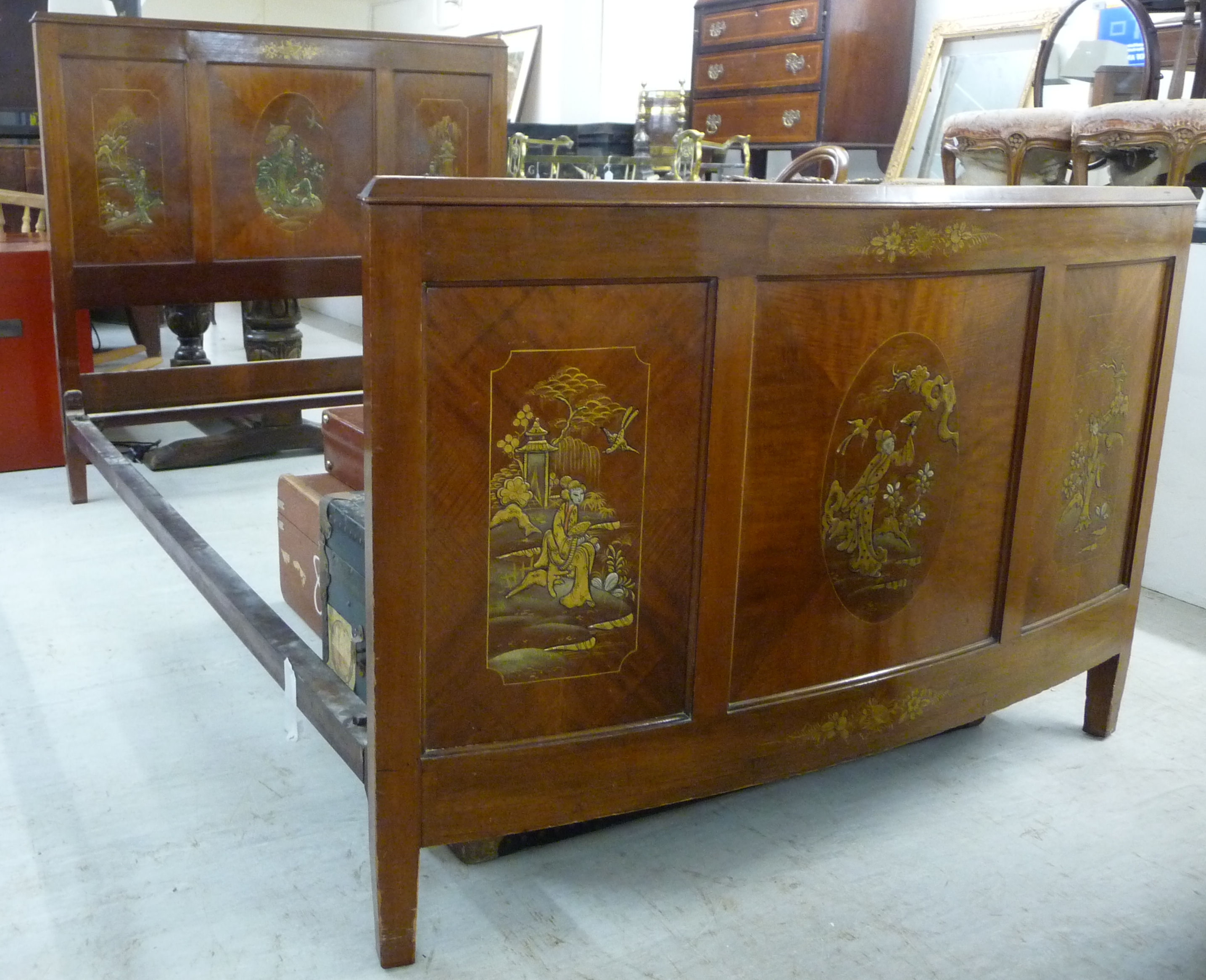 Lot 52 - A 1930s/50s mahogany bedhead and foot, the triple panelled headboard,