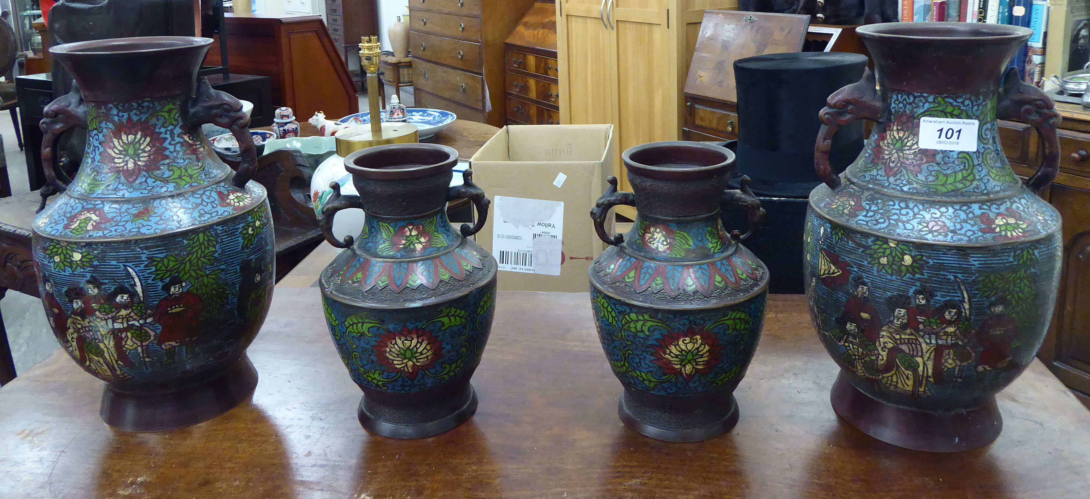 Lot 101 - A pair of early 20thC twin handled cloisonne vases of tapered, bulbous form,