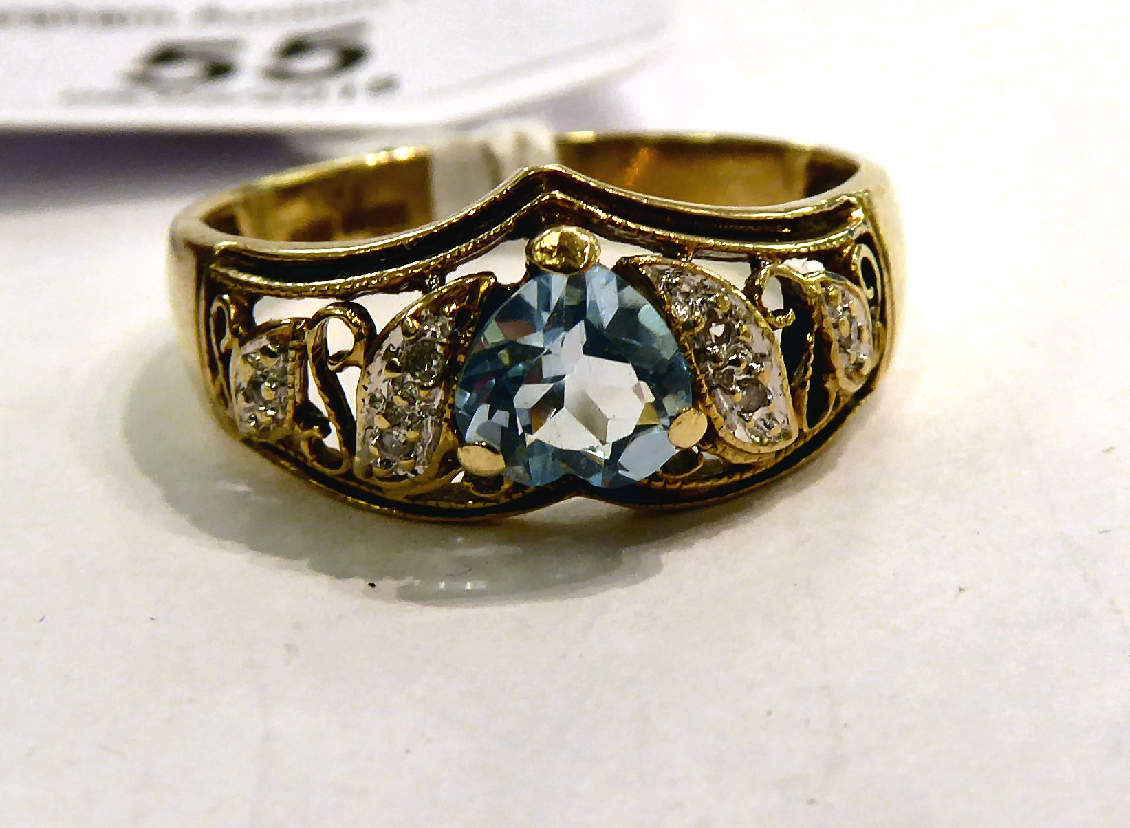 Lot 55 - A 9ct gold ring, set with a heart shaped topaz,