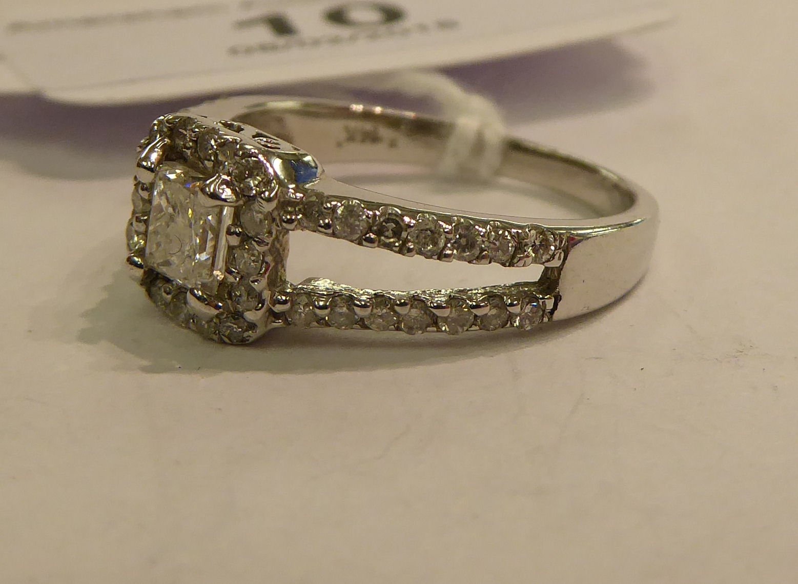 Lot 10 - A 14ct white gold diamond set cluster ring 11
