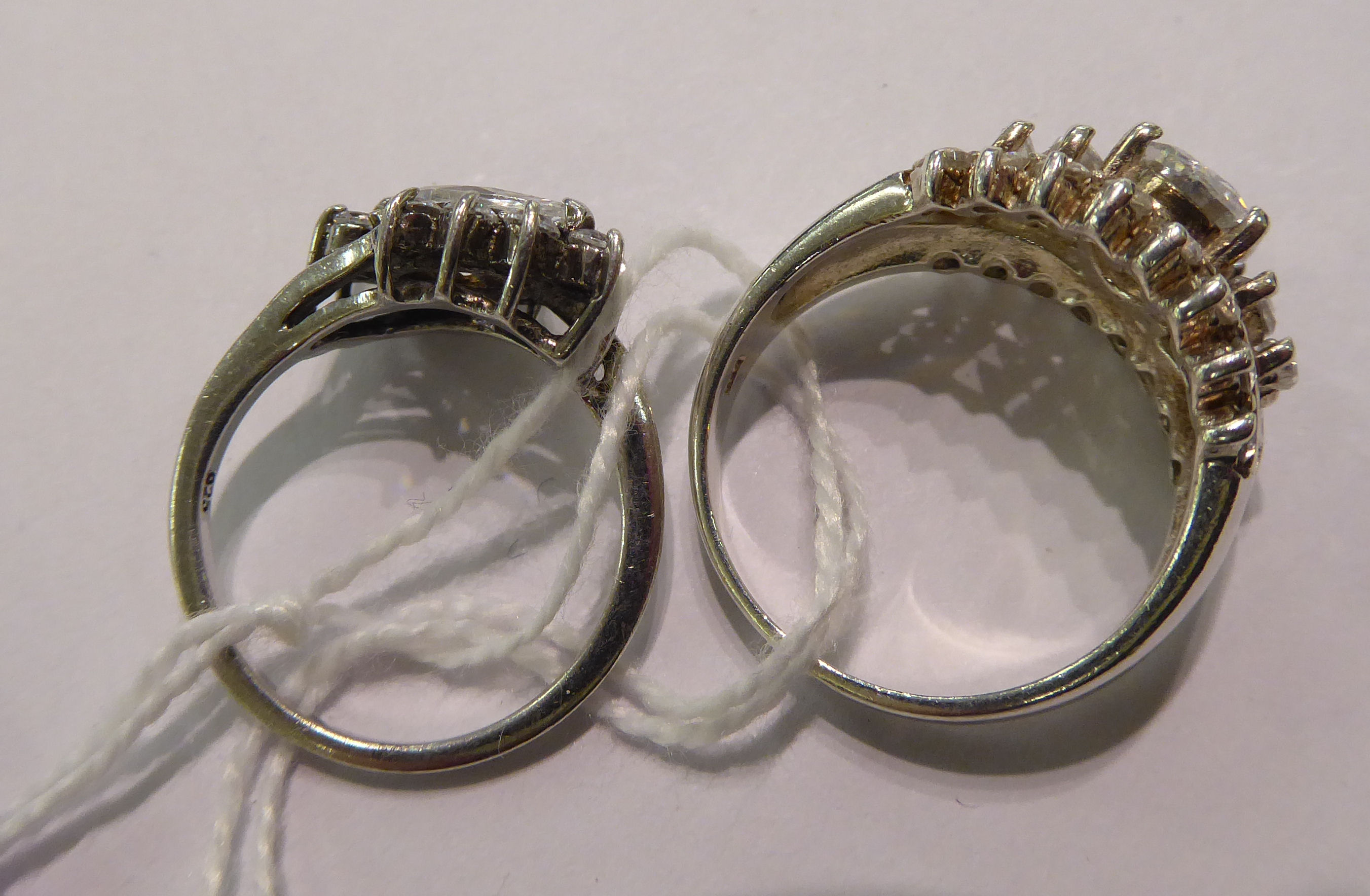 Lot 65 - Two silver coloured metal dress rings,