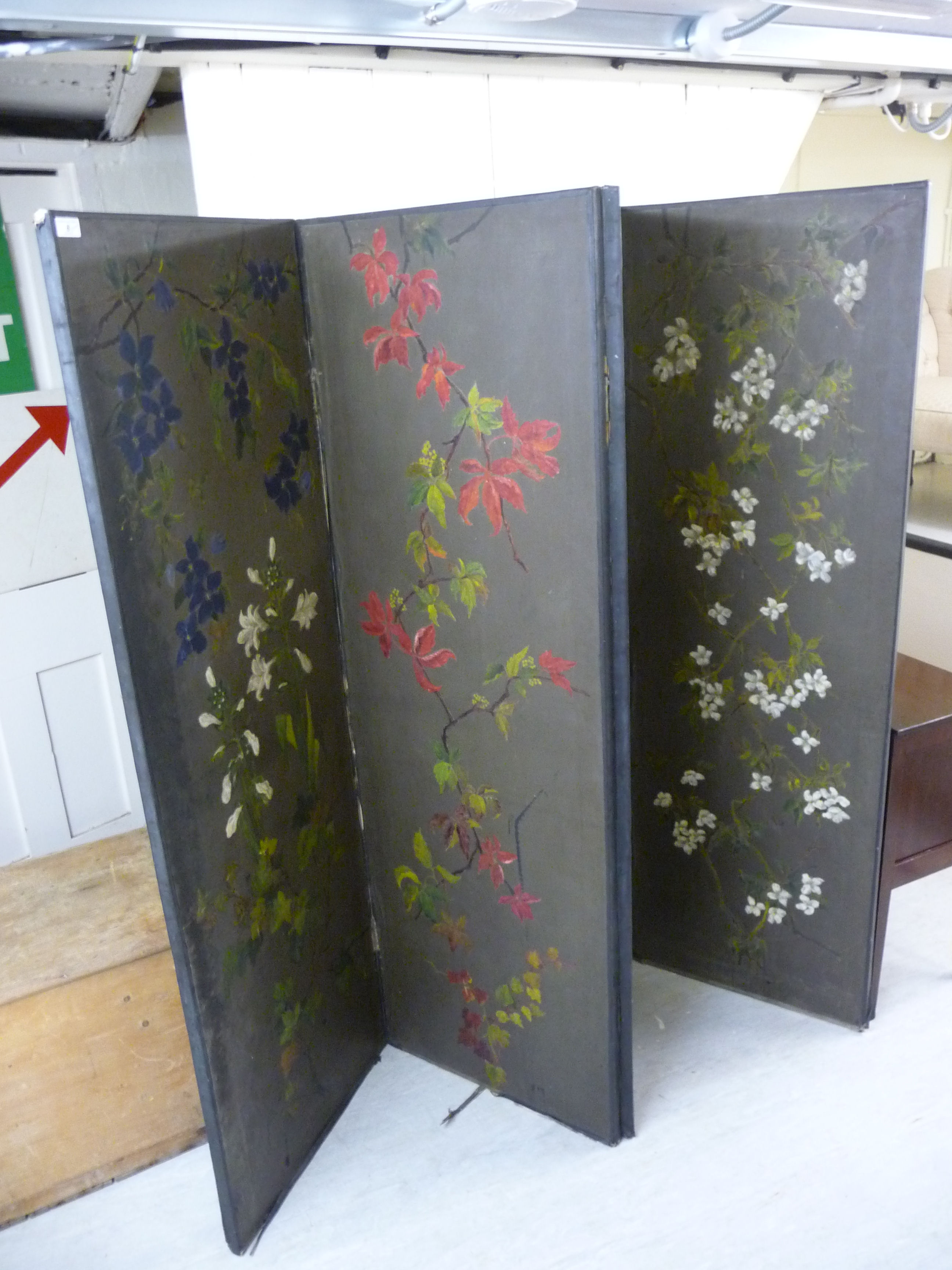 Lot 8 - An early 20thC Japanese inspired canvas covered, four-fold room screen,