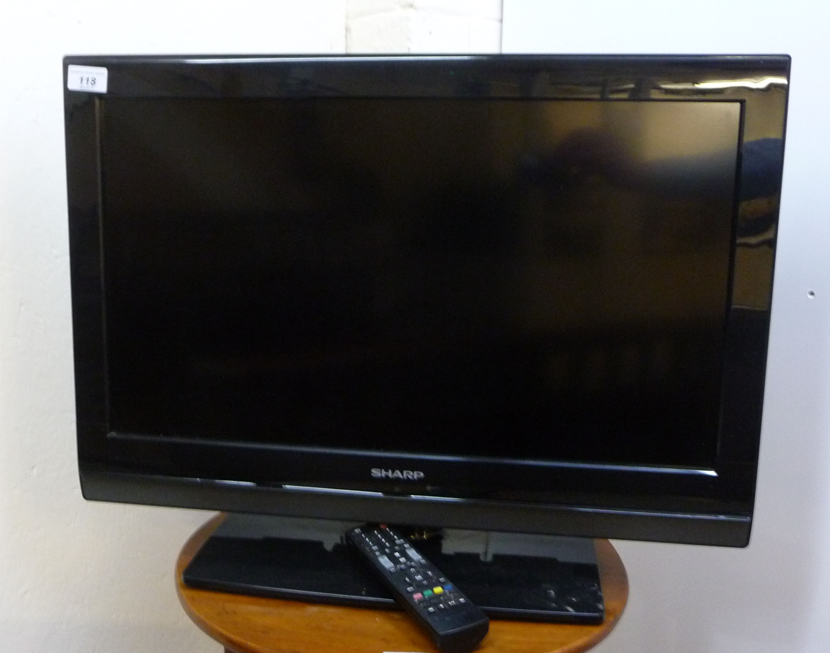 Lot 118 - A Sharp 23'' television with a remote control BSR