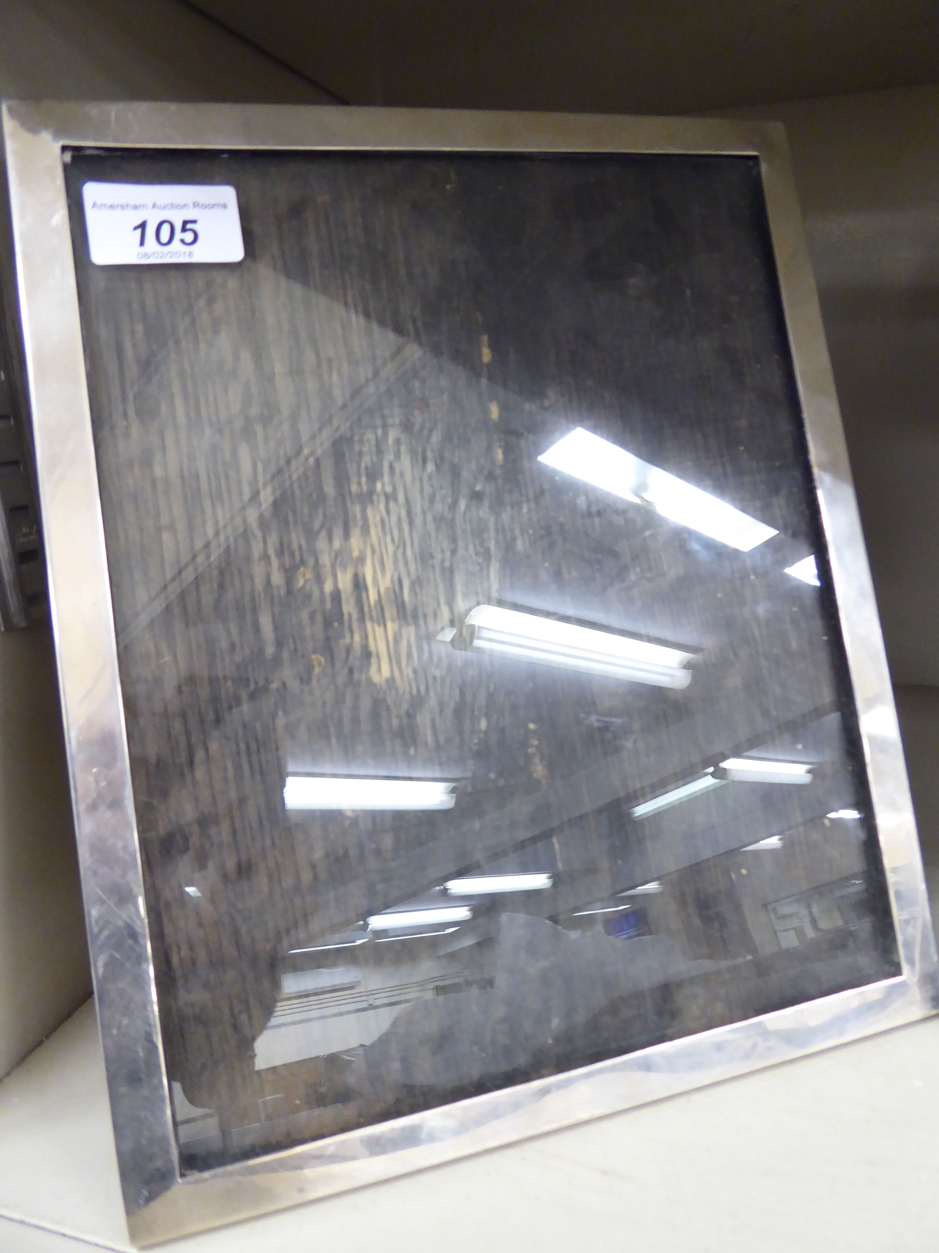 Lot 105 - A glazed silver photograph frame,