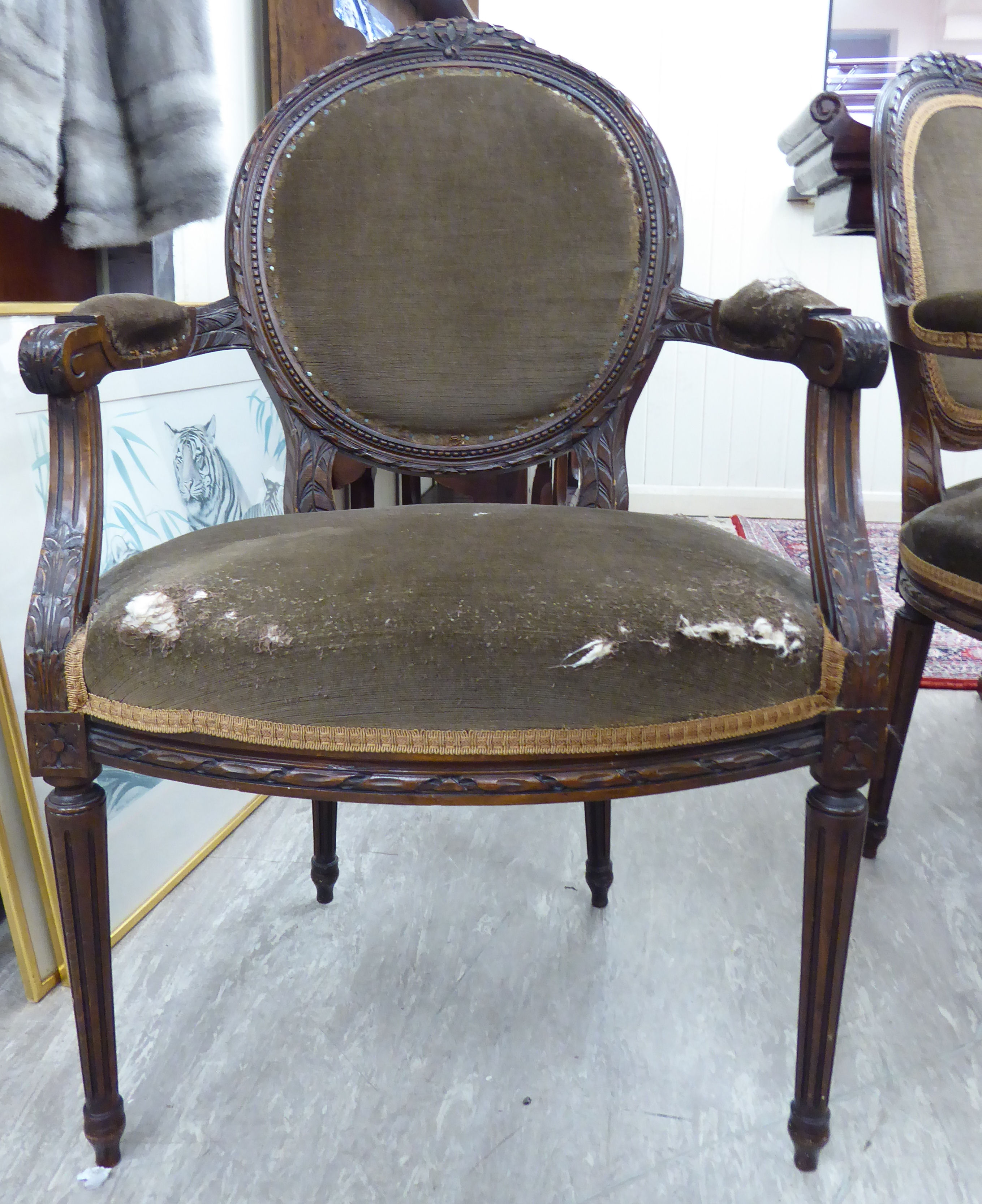 Lot 27 - A modern French inspired carved, stained beech, showwood framed salon chair,
