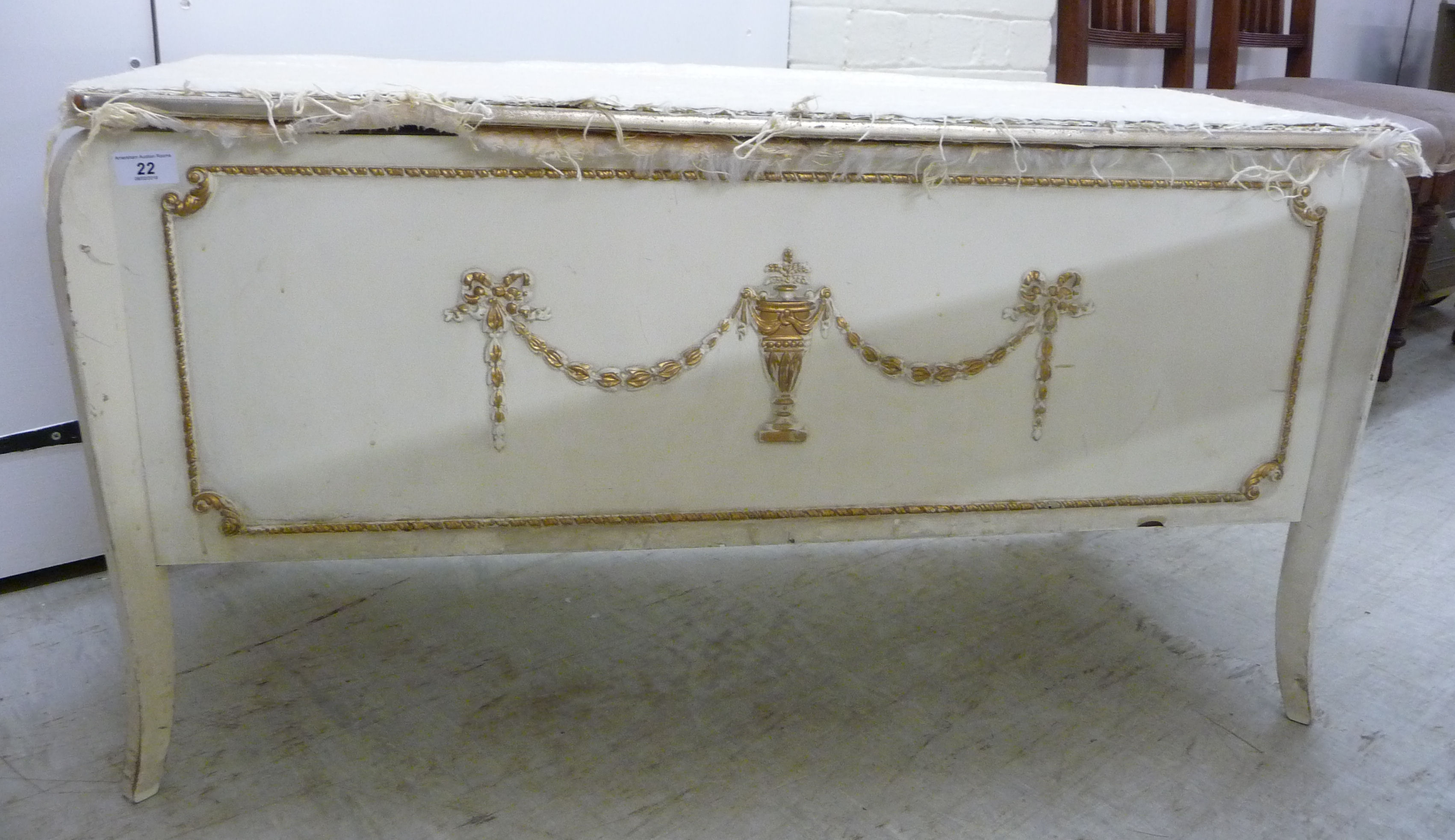 Lot 22 - A 1950s French inspired white painted ottoman with a hinged lid and straight sides,