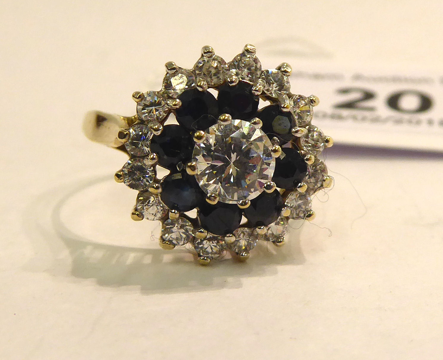 Lot 20 - A 9ct gold claw set sapphire and cubic zirconia cluster ring 11