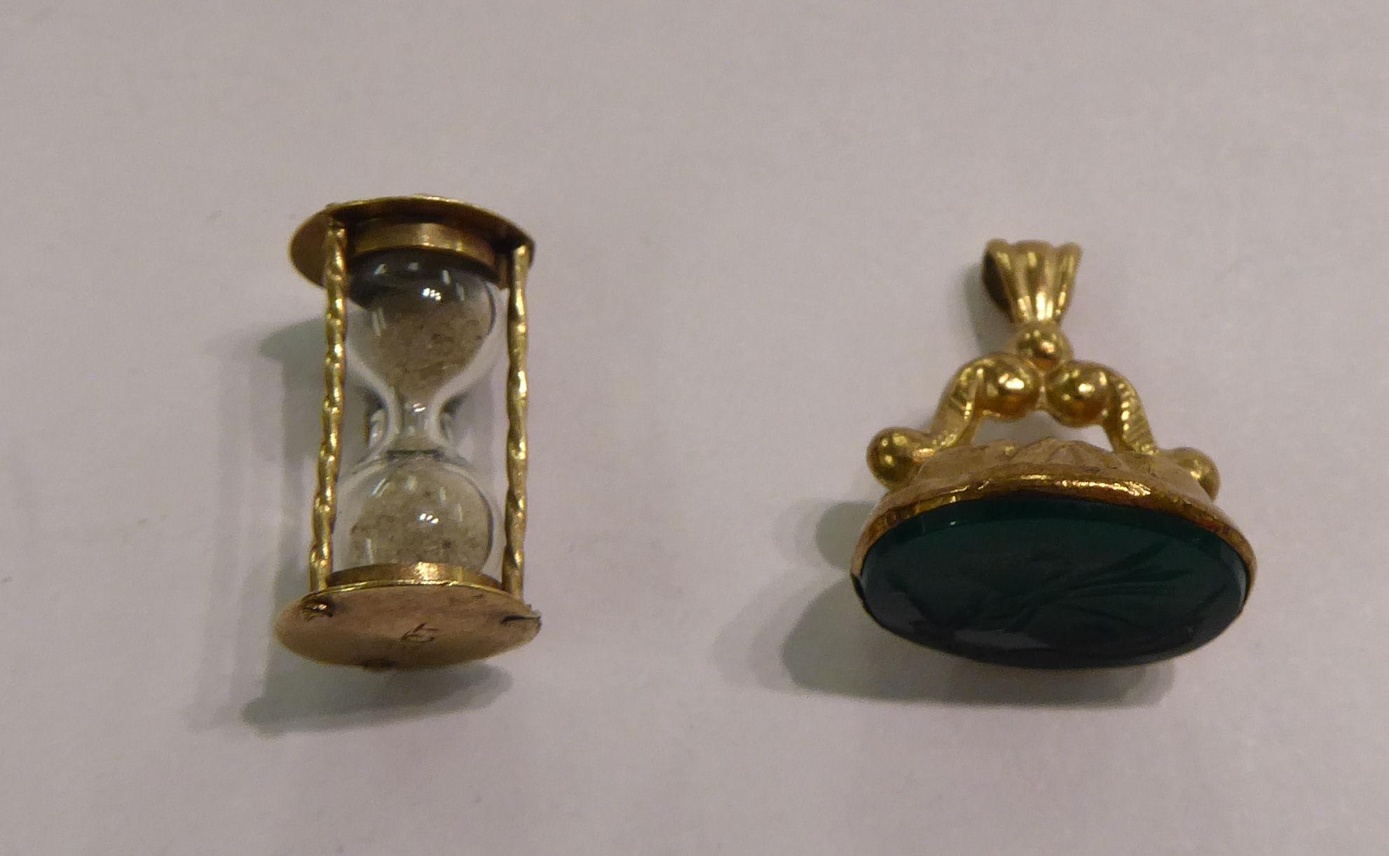 Lot 92 - A gold coloured metal pendant seal;