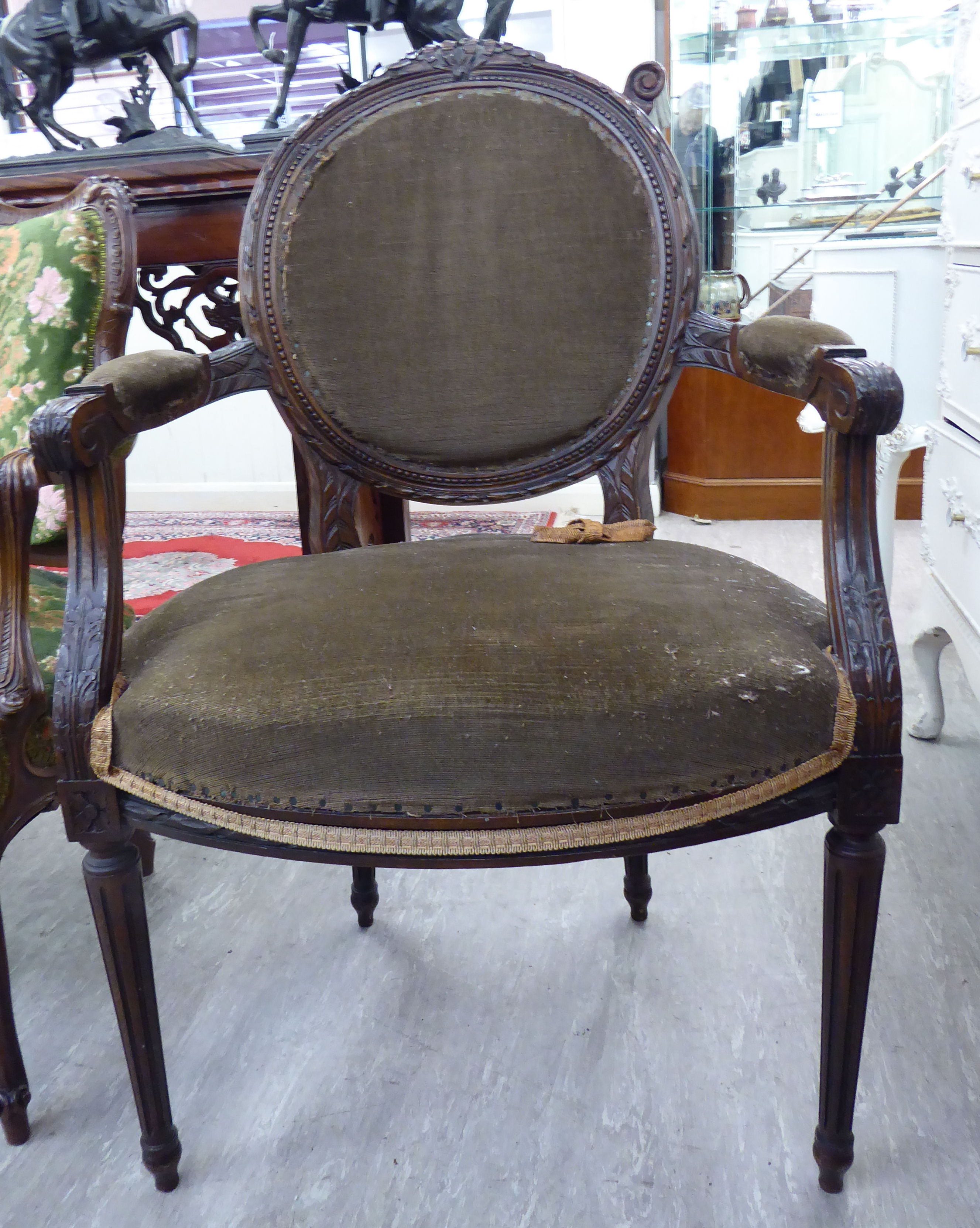 Lot 16 - A modern French inspired carved stained beech showwood framed salon chair,