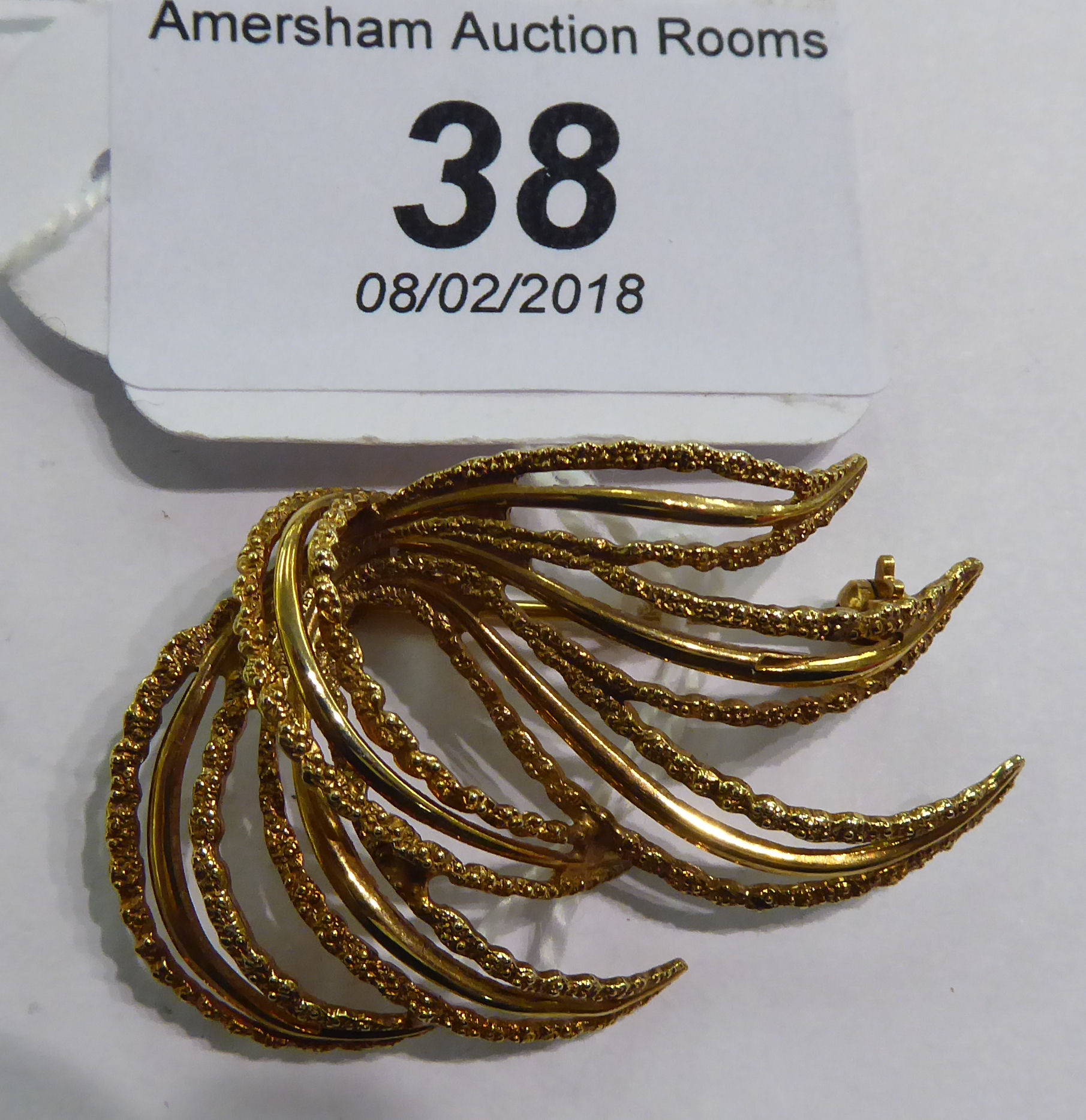 Lot 38 - A 9ct gold part textured,