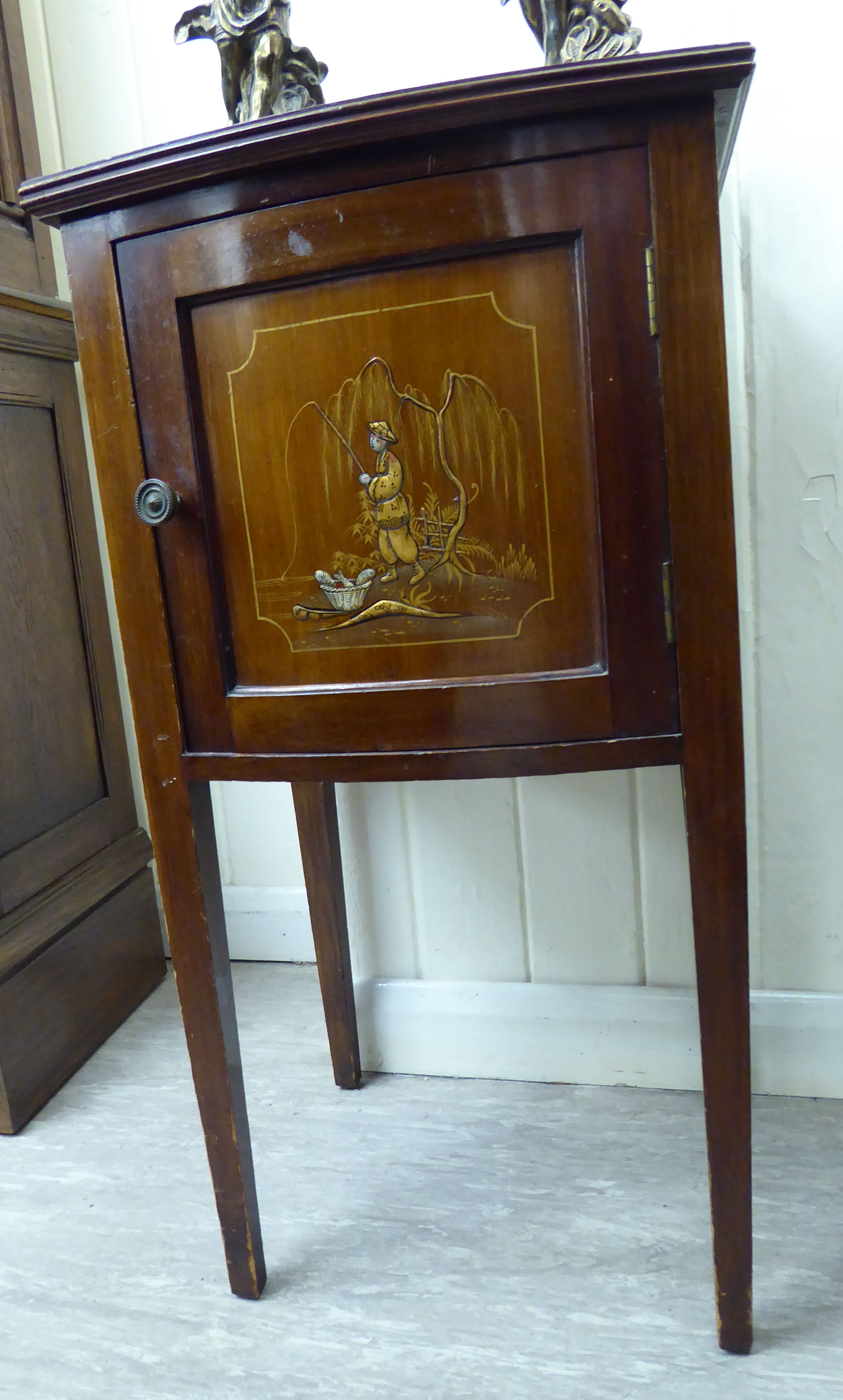 Lot 32 - A 1930s/50s Japanese inspired mahogany and gilded bow front bedside cupboard with a single panelled