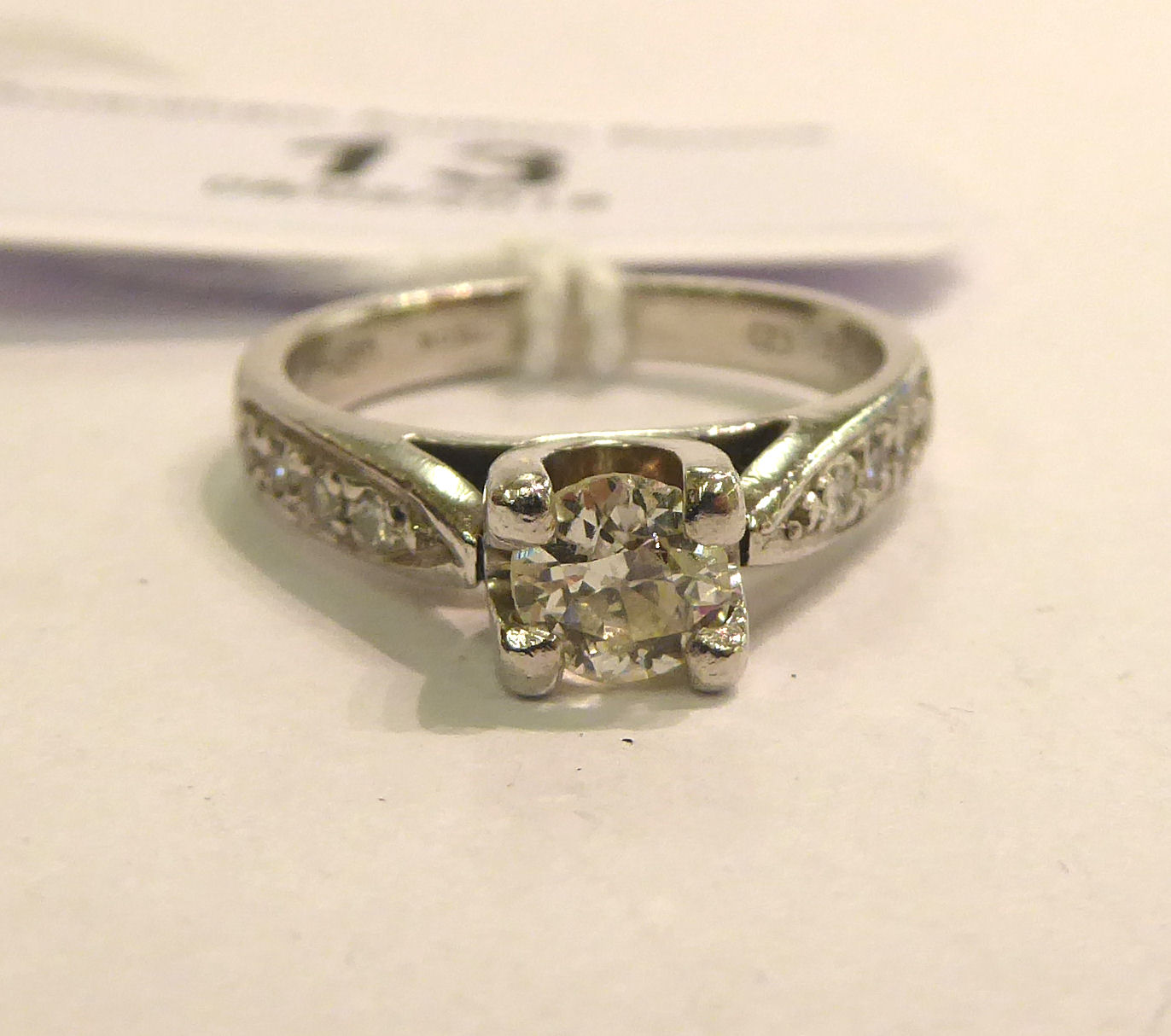 Lot 13 - A platinum and diamond set solitaire ring 11