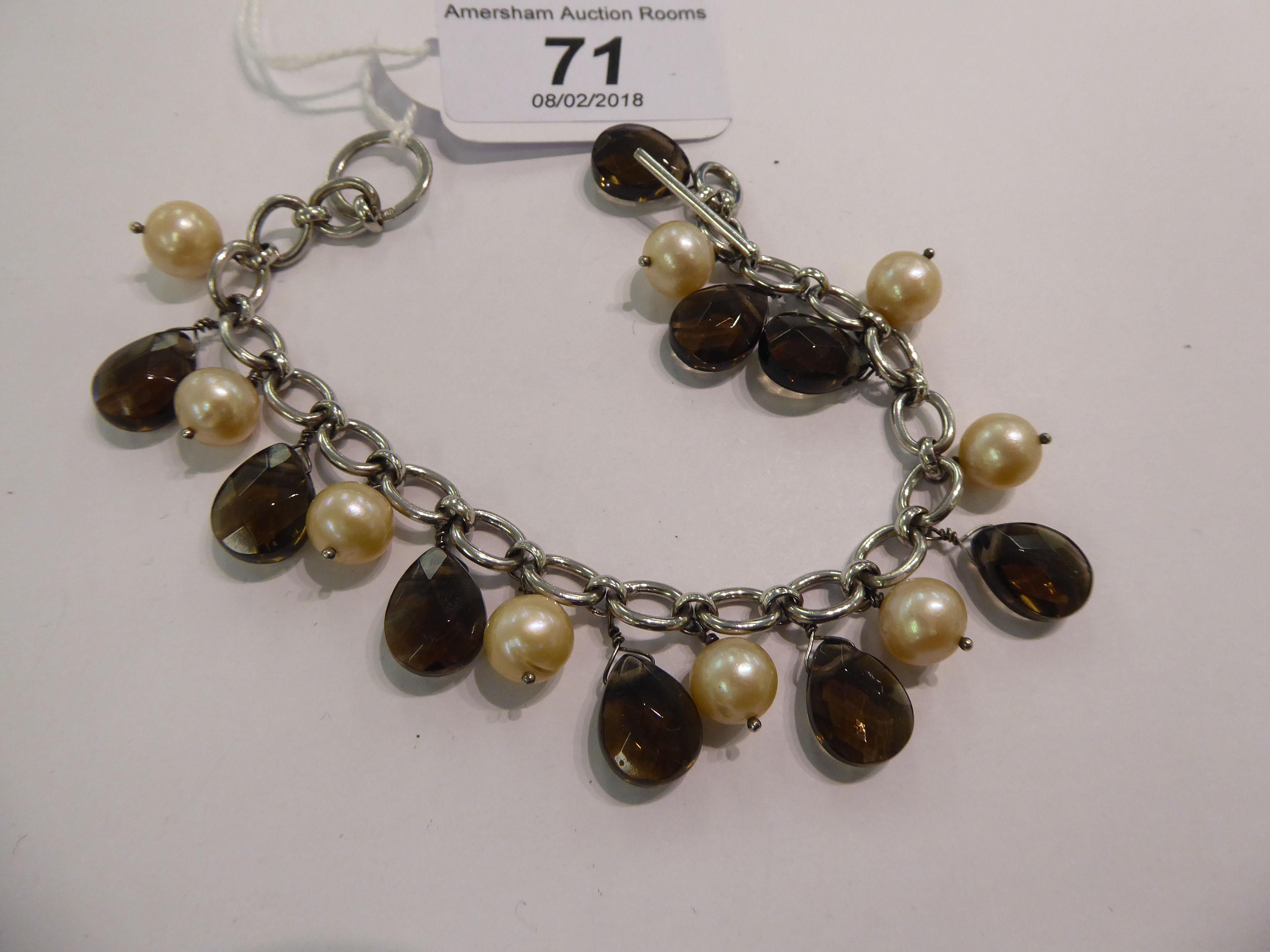 Lot 71 - A silver coloured metal bracelet stamped 925,