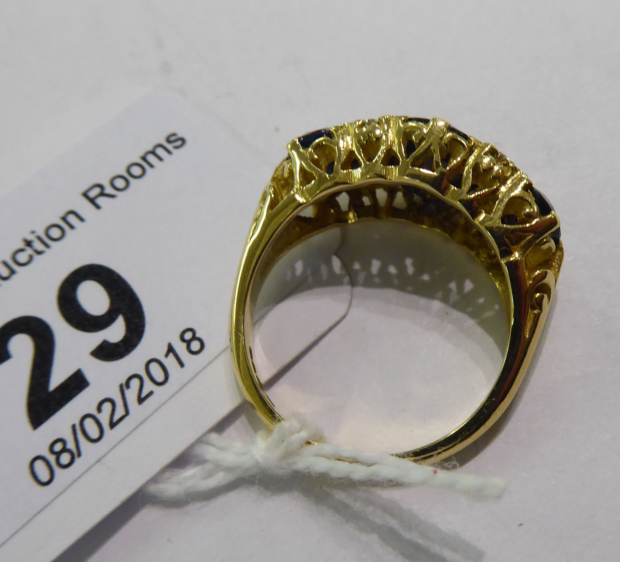 Lot 29 - An 18ct gold claw set sapphire and diamond ring 11