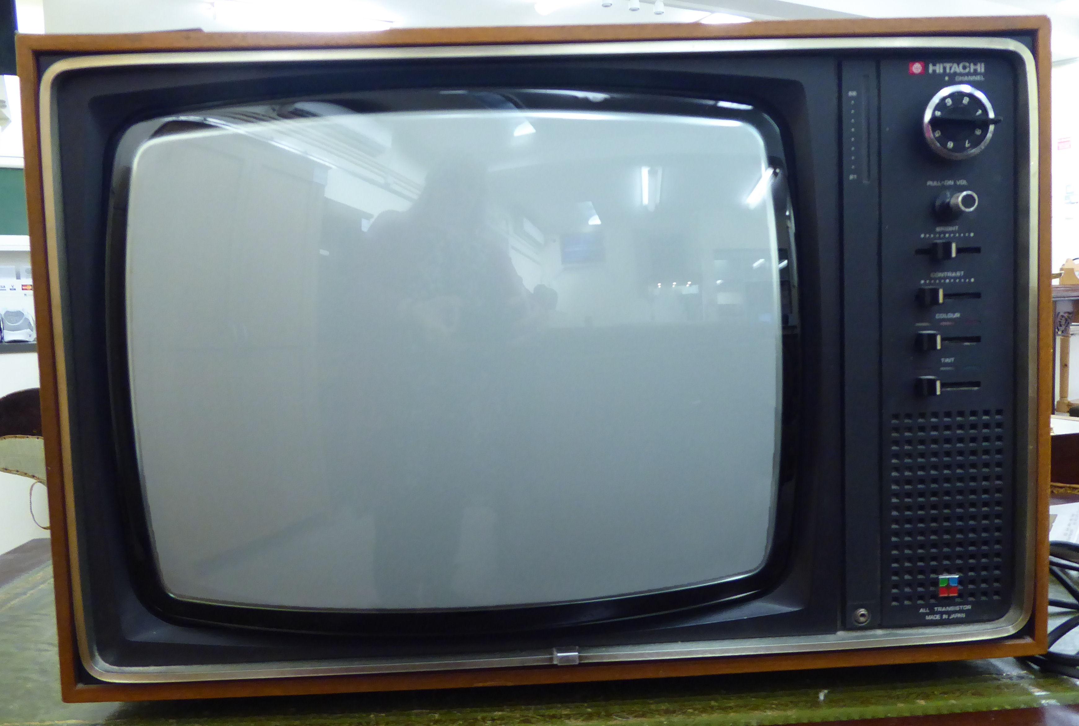 Lot 56 - A 'vintage' Hitachi 18'' teak cased television set RAM