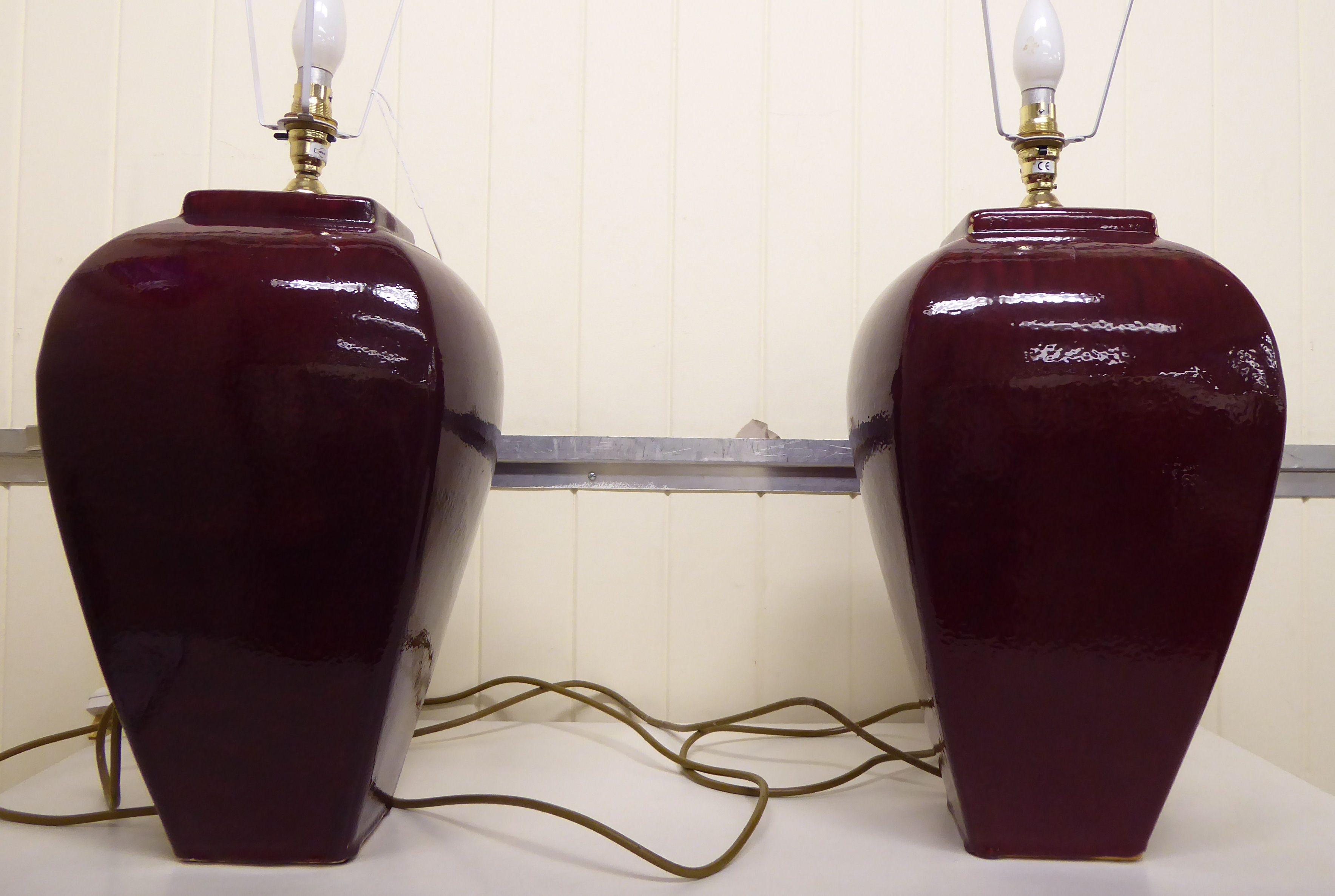 Lot 117 - A pair of modern Chinese sang de boeuf glazed china vase design table lamps,