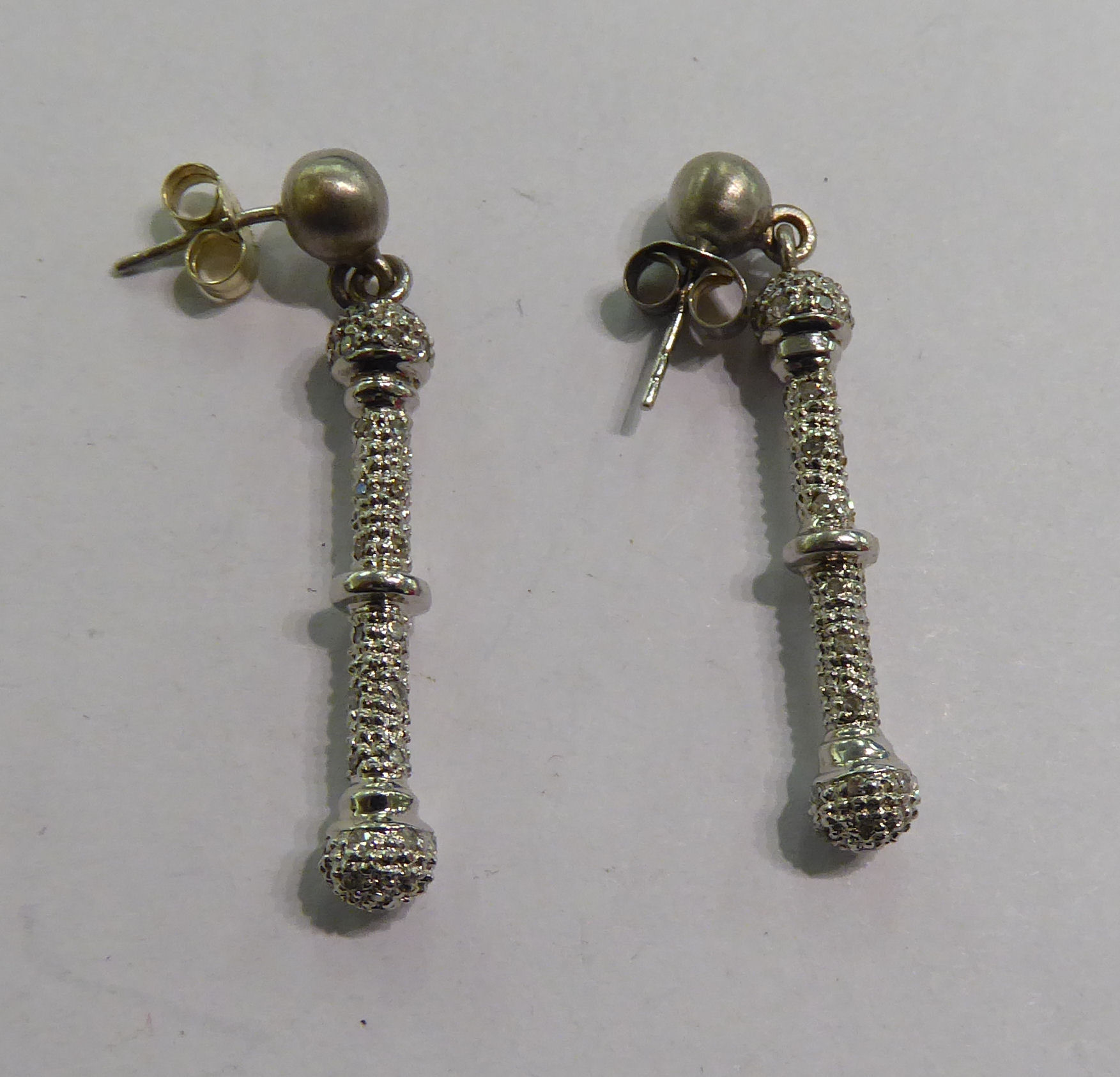 Lot 95 - A pair of 9ct white gold diamond set ball design earrings 11