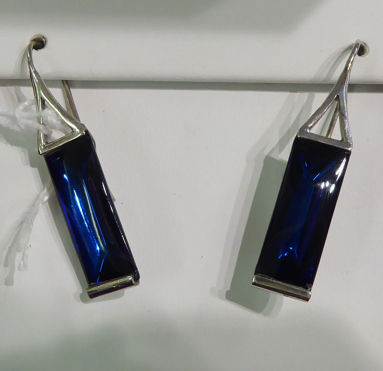 Lot 100 - A pair of Baccarat white metal blue glass pendant earrings stamped 925 boxed 11