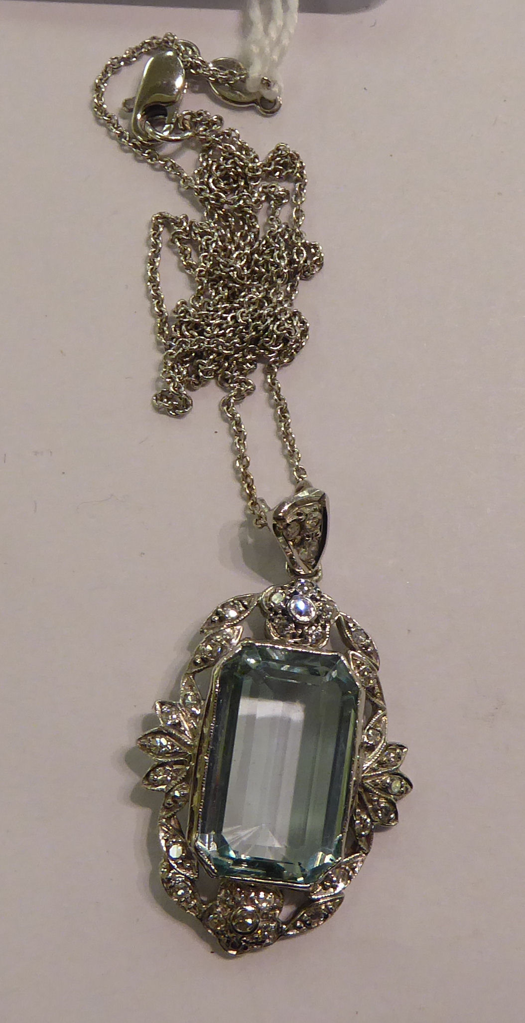 Lot 114 - An 18ct white gold pendant necklace,