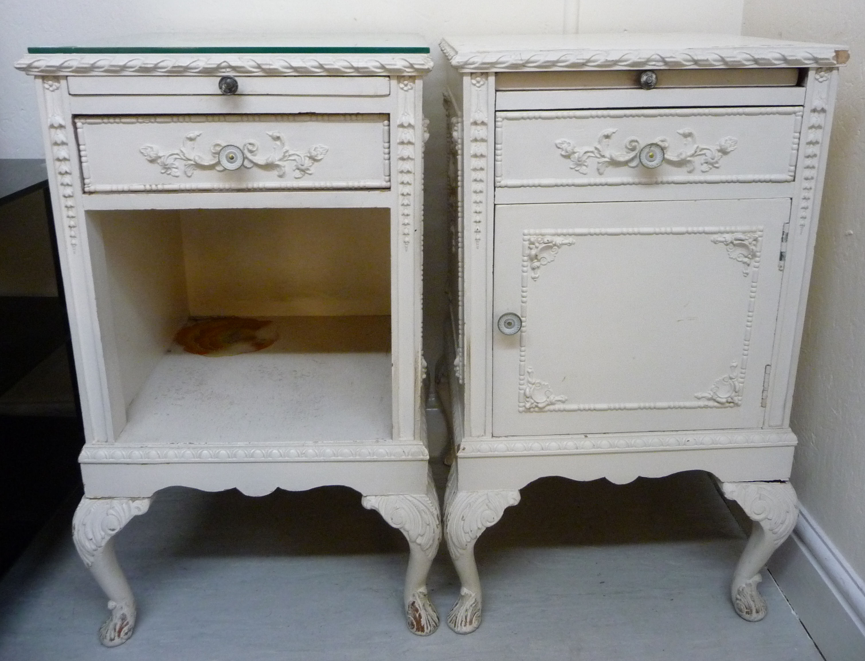 Lot 48 - A matched pair of 1950s French inspired white painted bedside cabinets,