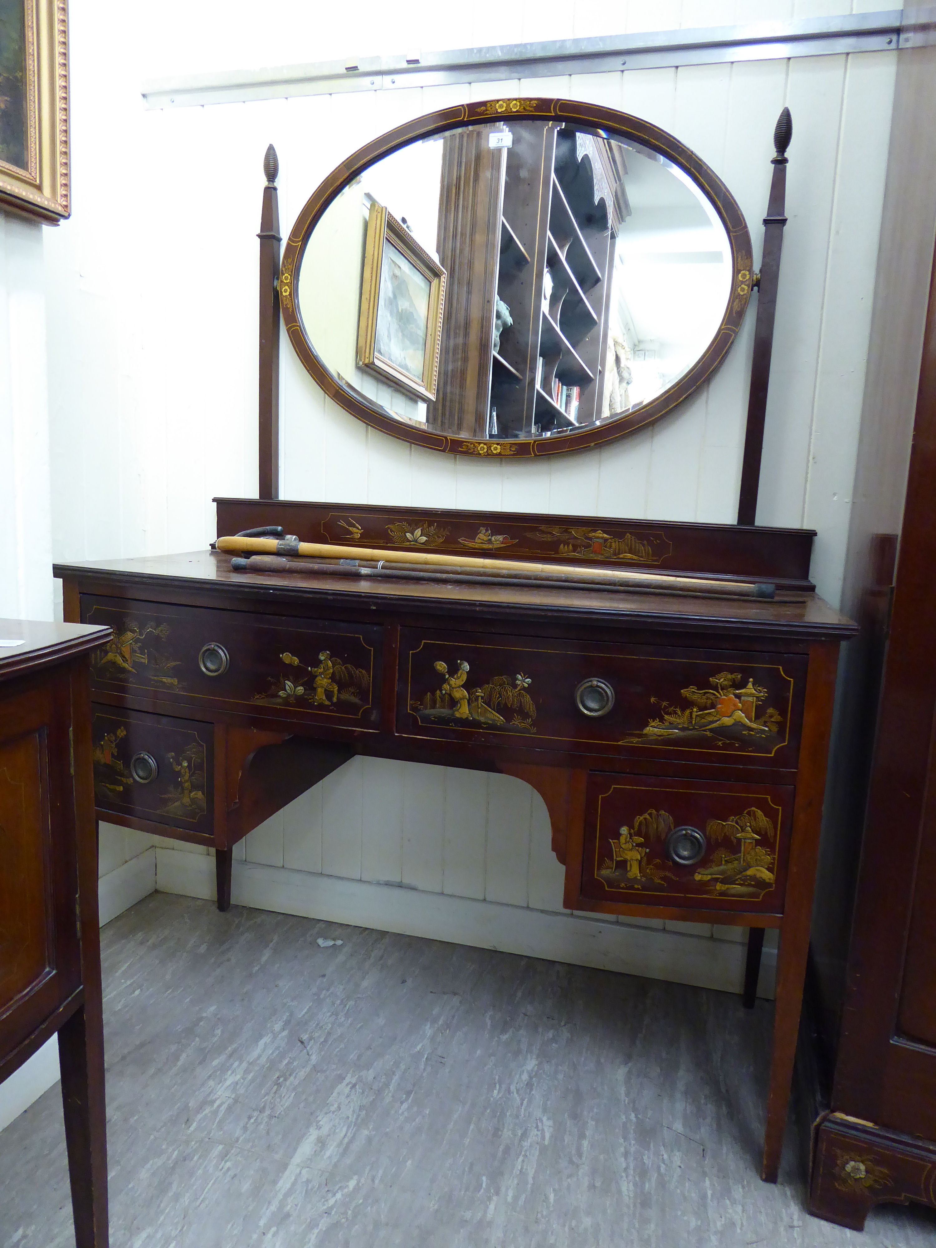 Lot 31 - A 1930s/50s mahogany and gilded four drawer kneehole dressing table,