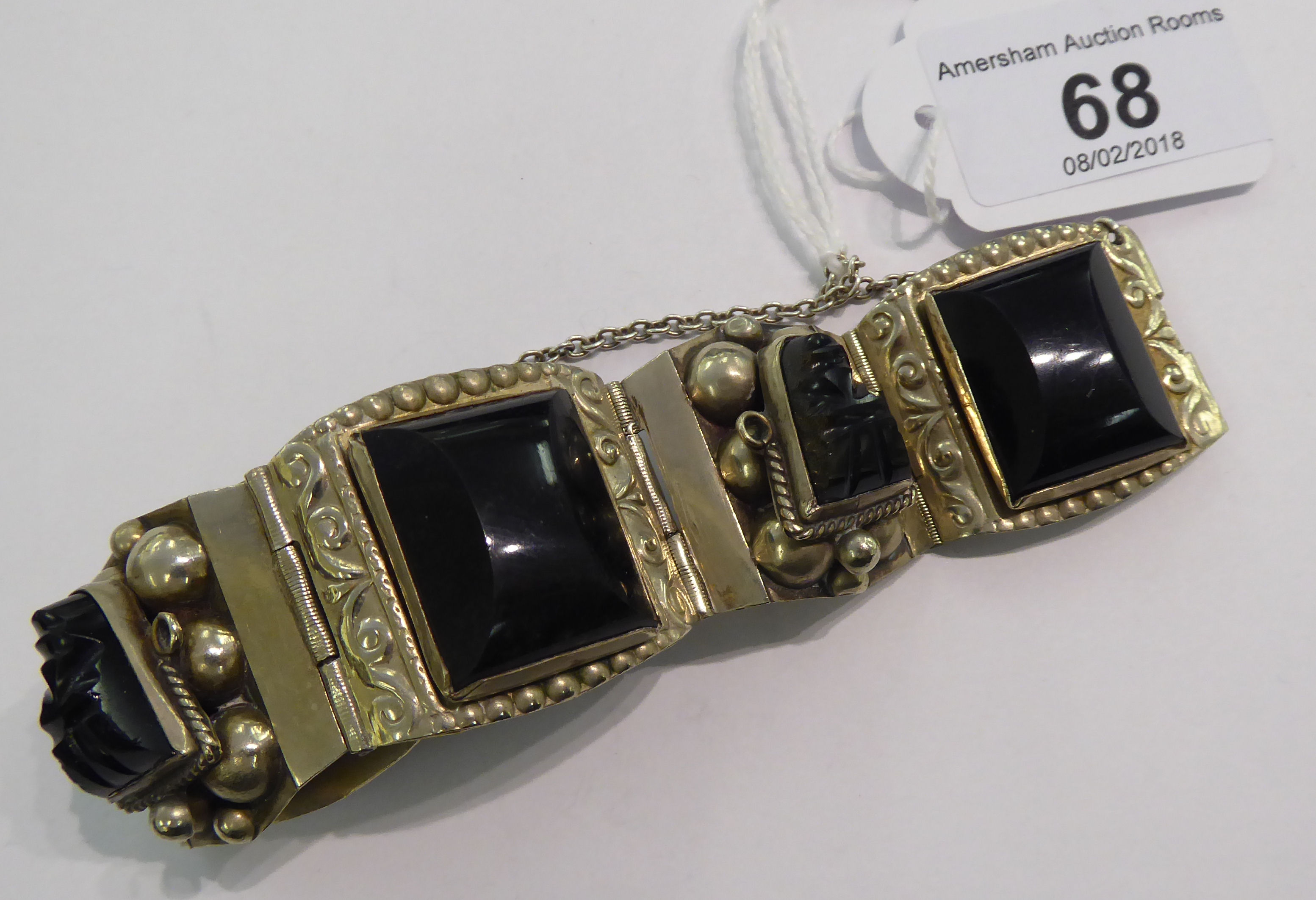 Lot 68 - A Mexican white metal gatelink bracelet, set with onyx bead ornament,