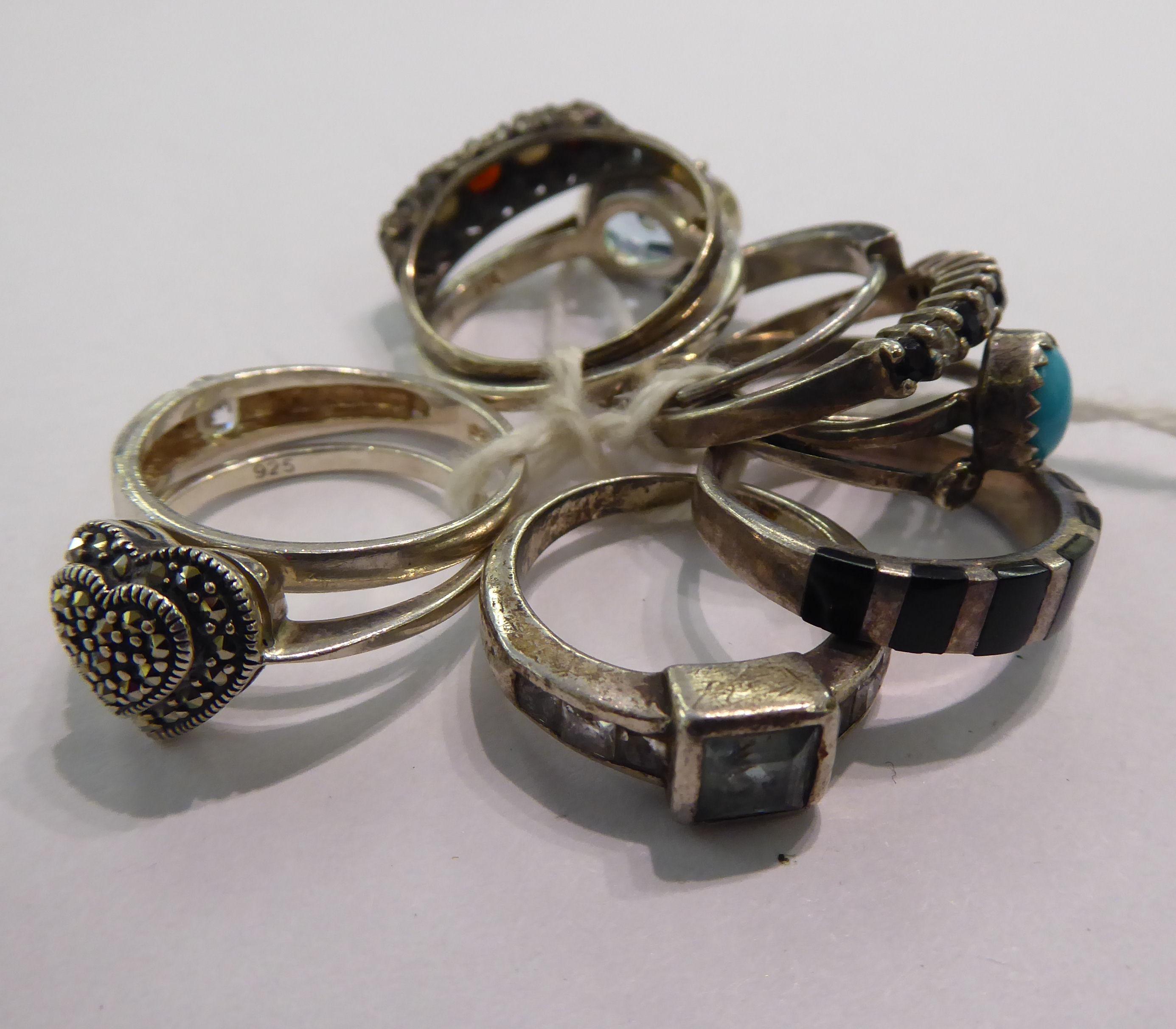 Lot 51 - Nine white metal rings,