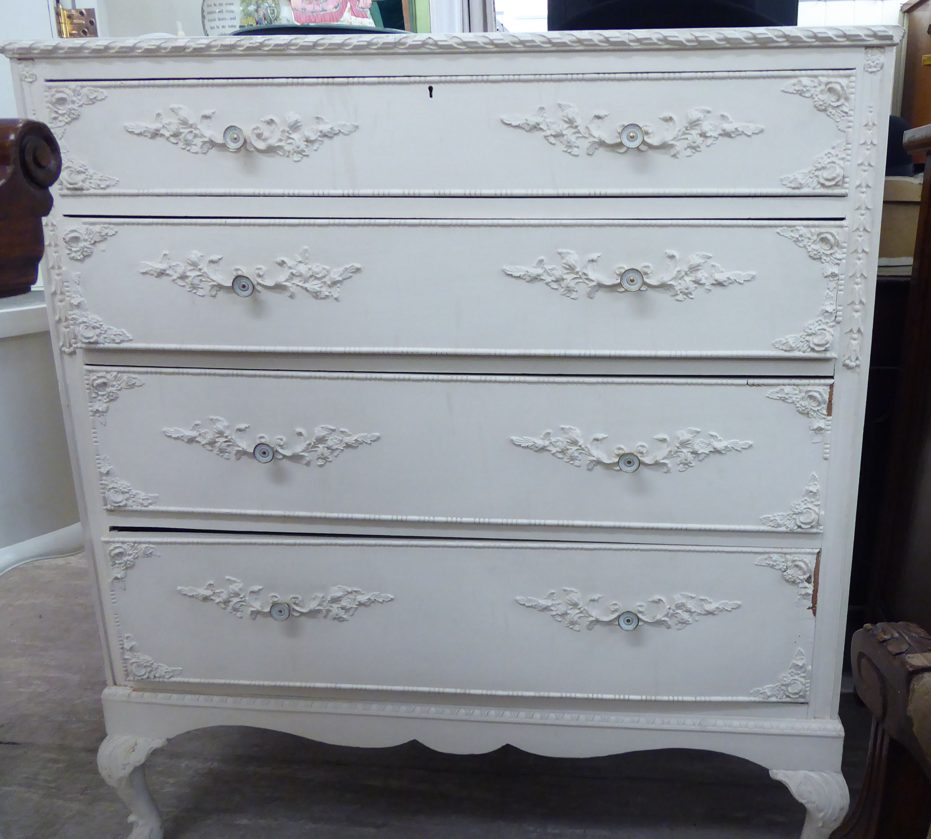 Lot 30 - A 1950s French inspired white painted four drawer dressing chest,