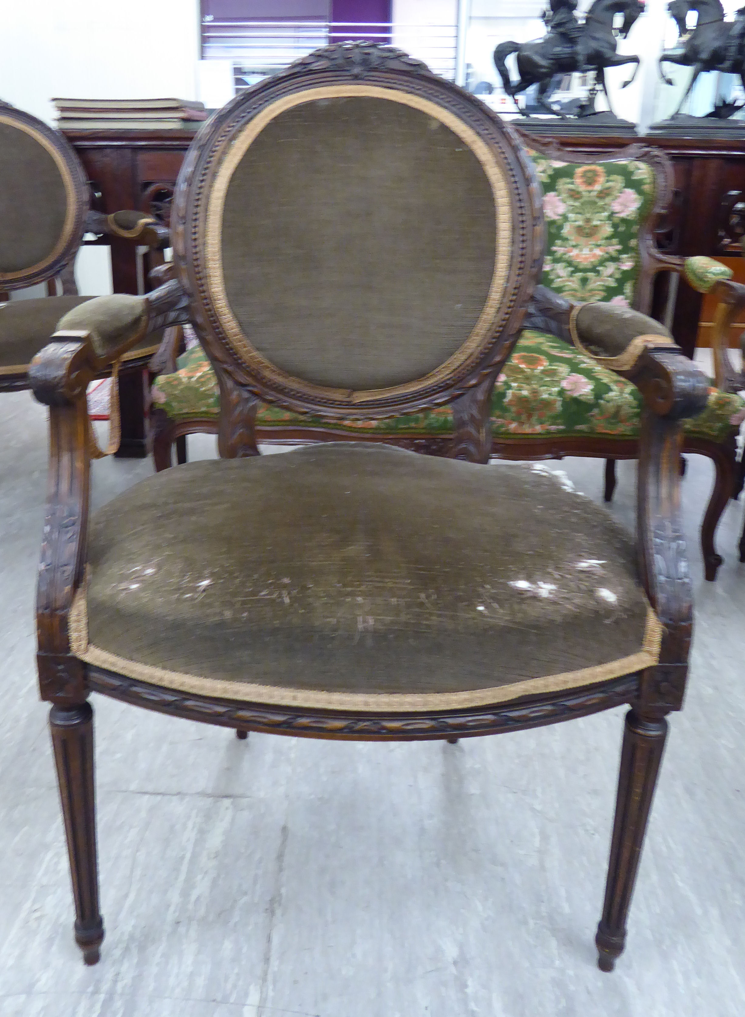 Lot 46 - A modern French inspired carved, stained beech showwood framed salon chair,