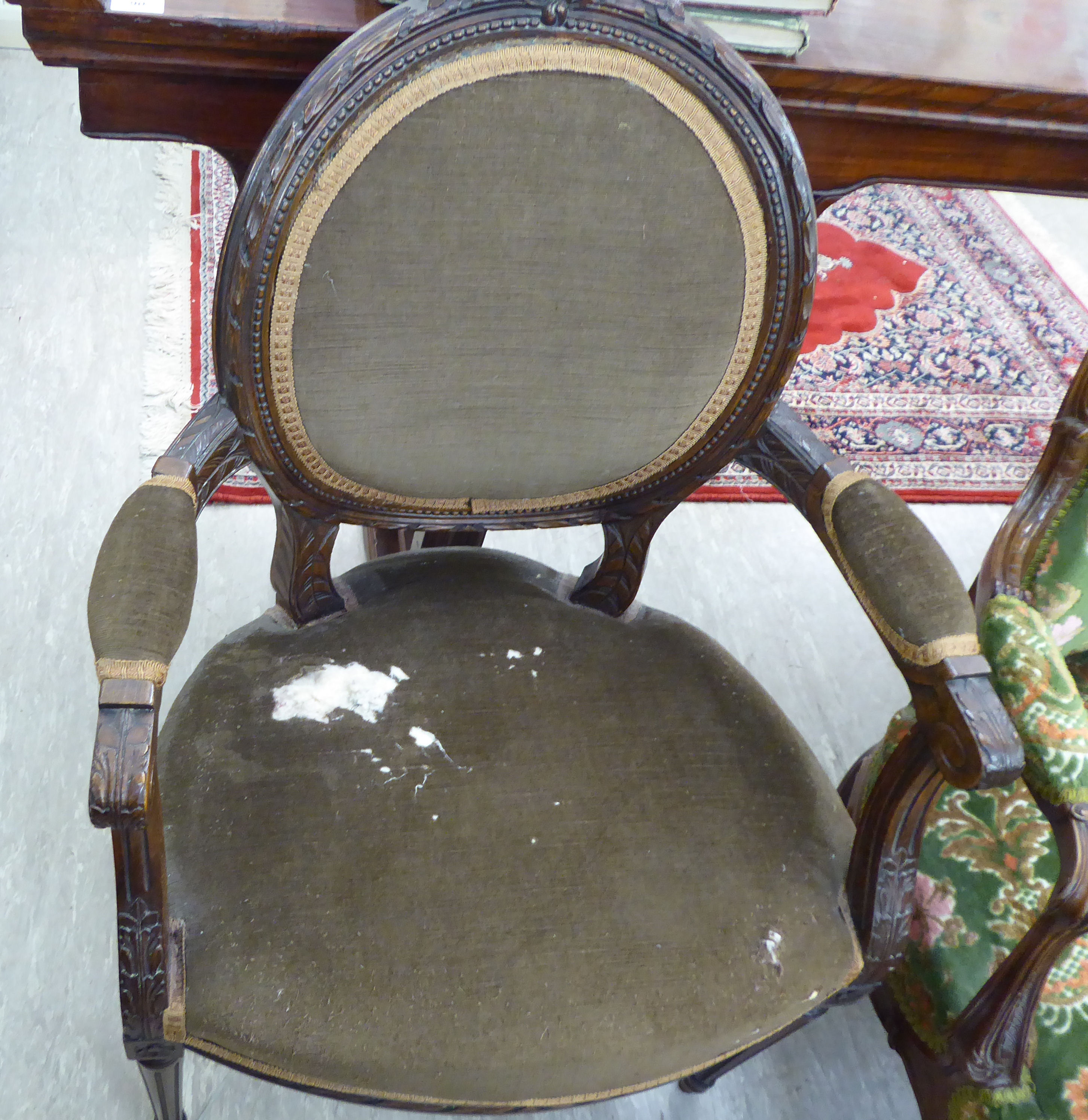 Lot 19 - A modern French inspired carved stained beech showwood framed salon chair,