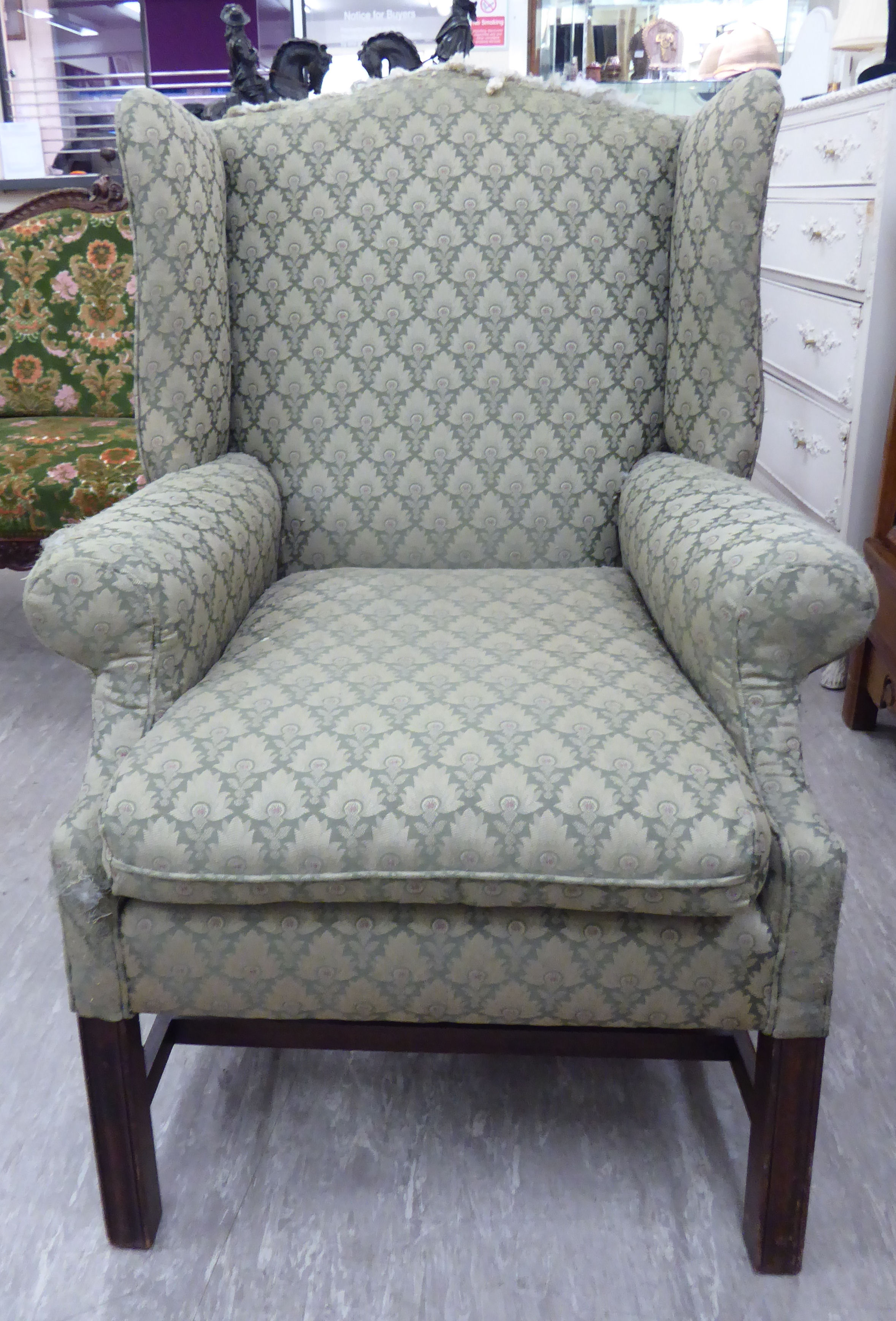 Lot 58 - A modern Georgian style upholstered wingback armchair,