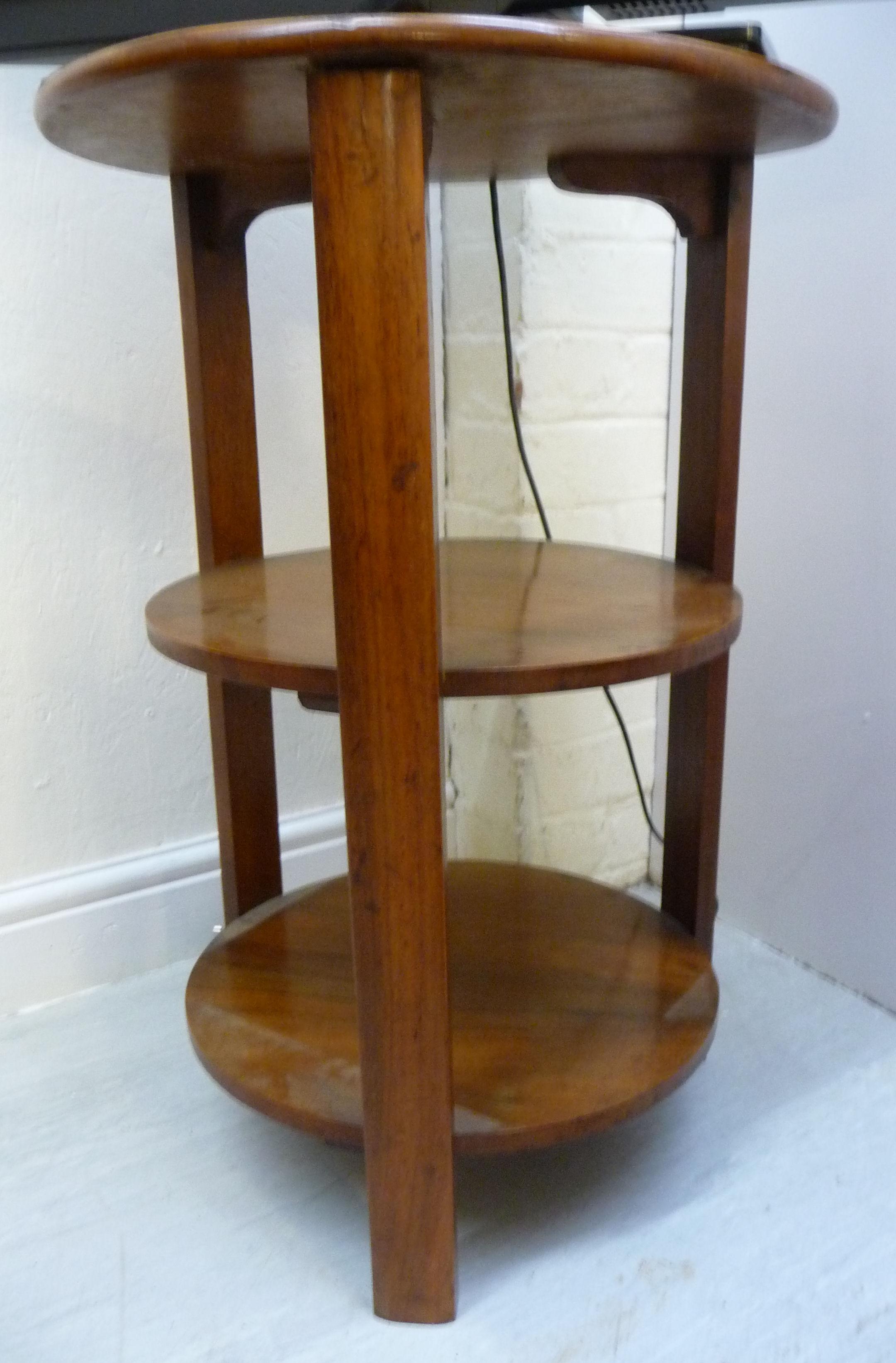 Lot 91 - A mid 20thC mahogany three tier occasional table,