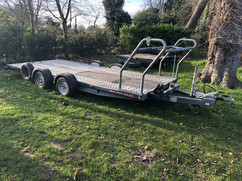 Lot 74 - BRIAN JAMES TRAILERS TWIN AXLE C4 BLUE 2600KG VEHICLE TRAILER WITH WHEEL RACK & WINCH *PLUS VAT*