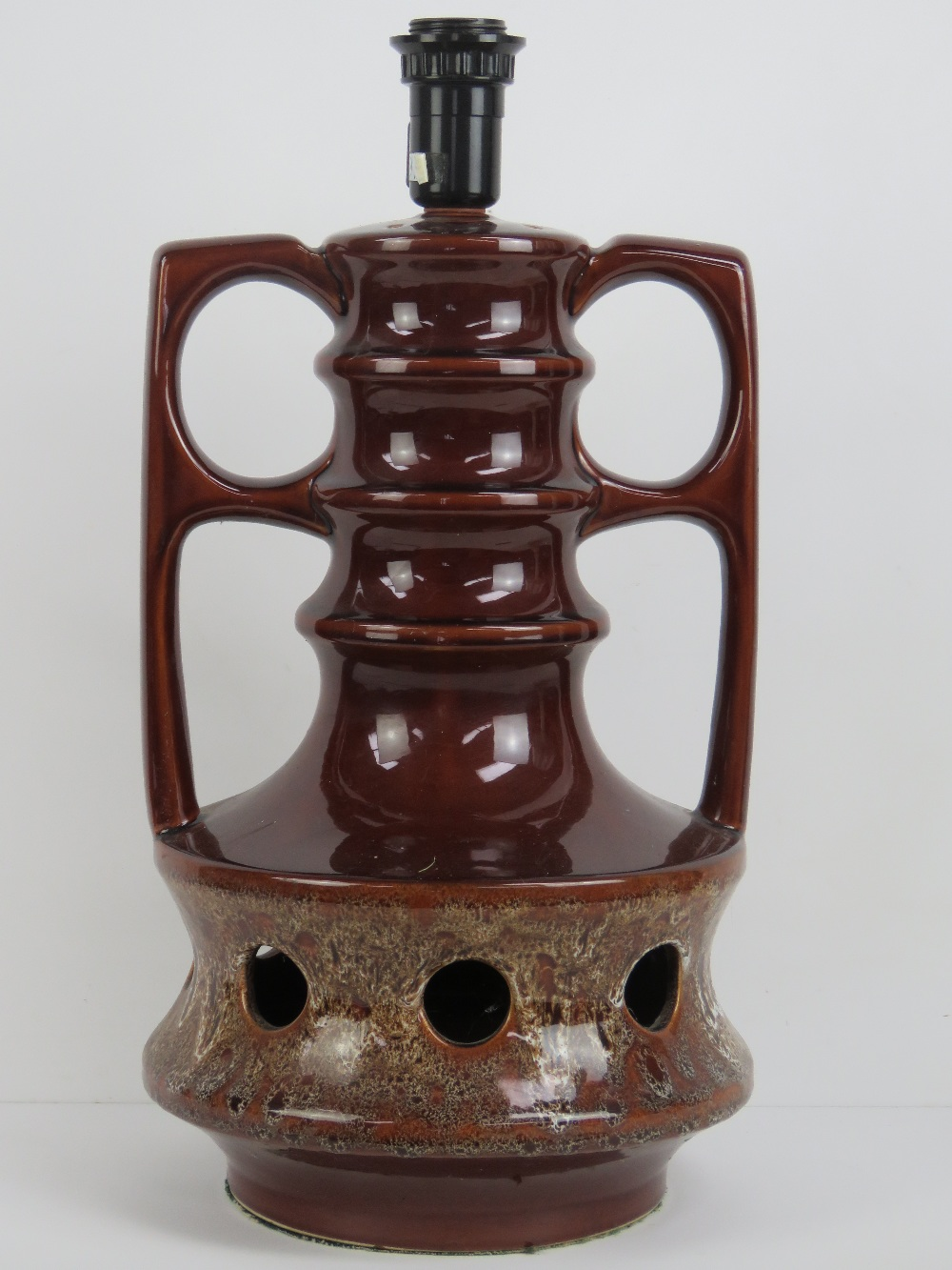 Lot 429 - A ceramic lamp having light fittings to top and base, standing 48cm high, for rewiring.