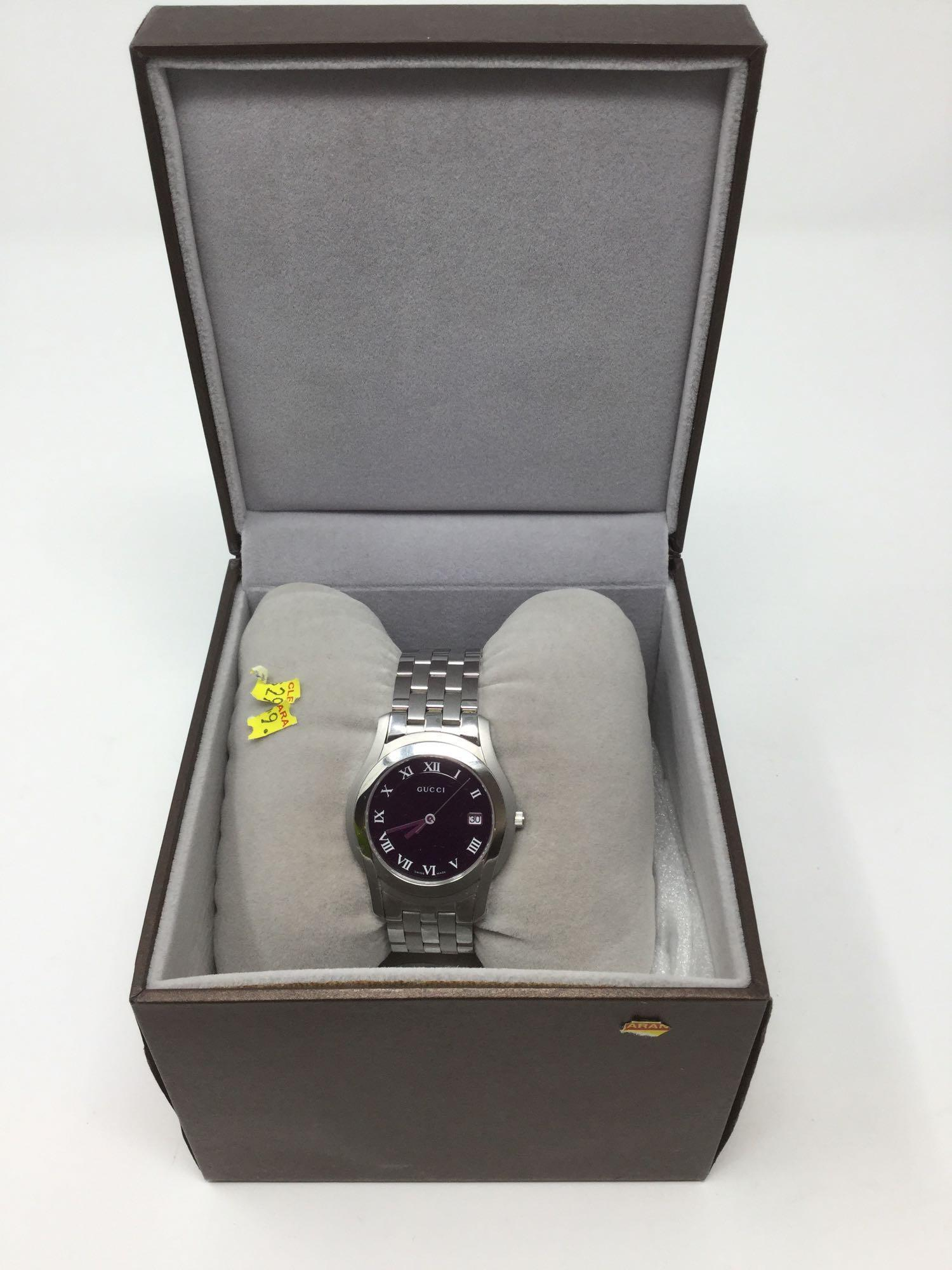 Lot 2 - Gucci Watch - woman's Silver band and Black Face