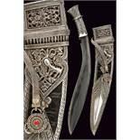 A beautiful silver mounted kukri with belt