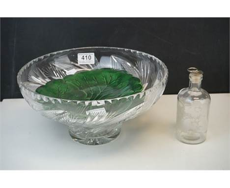 A cut glass fruit bowl  an antique green leaf plate together with an etched glass bottle with stopper.