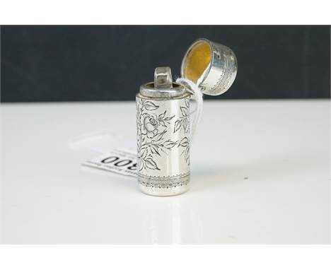 Silver Scent Bottle with engraved floral decoration, the hinged lid opening to reveal a glass stopper, 6cms high