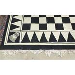 An HRA black and white chequered carpet, 256 x 365cm.