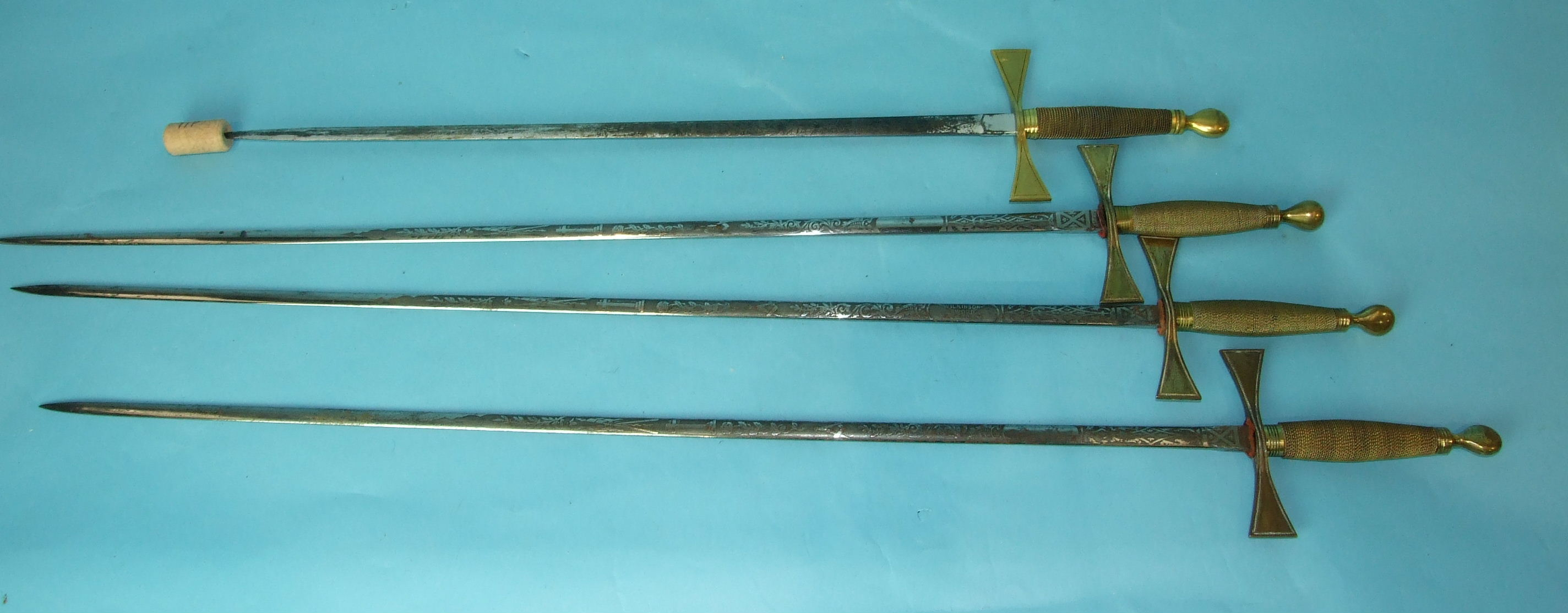 Lot 29 - Four Wilkinson Masonic swords with etched blades and gilt wire-bound grips, (scabbards lacking), (