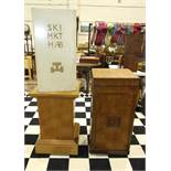 A Masonic oak pedestal with applied wood symbols, on castors, a square-form oak pedestal on