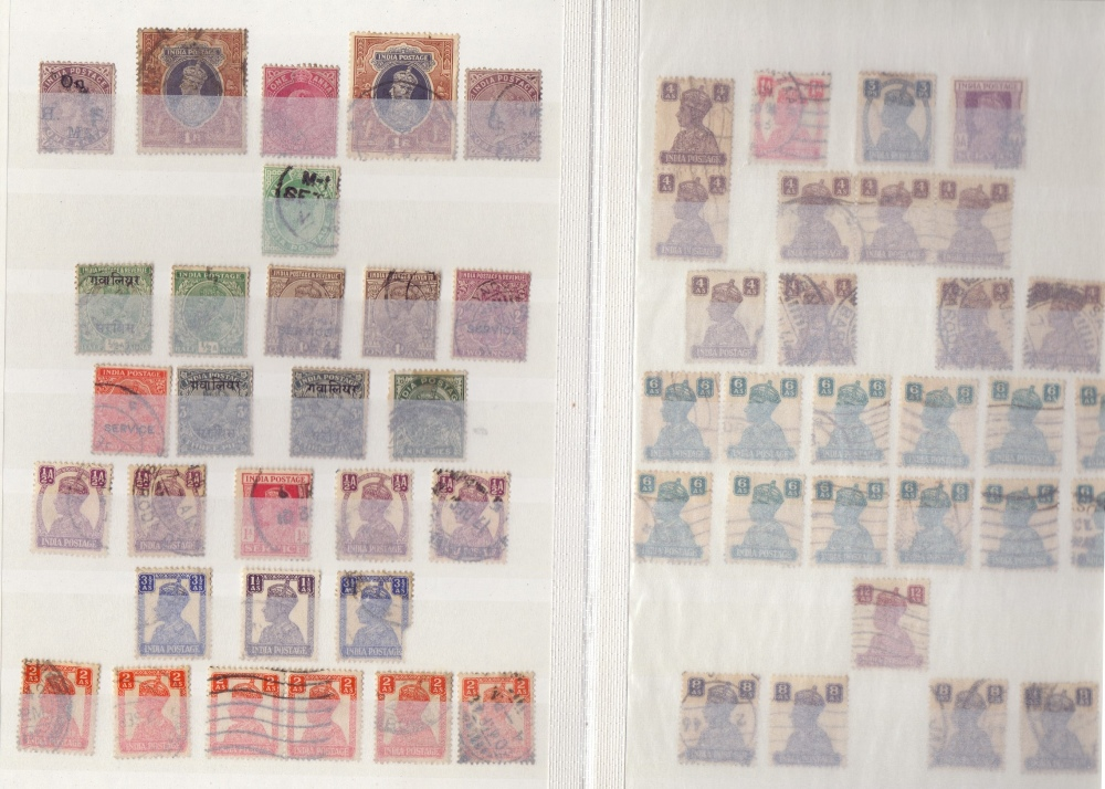 Lot 31 - STAMPS : Small stock book with issues from India and Japan mainly used
