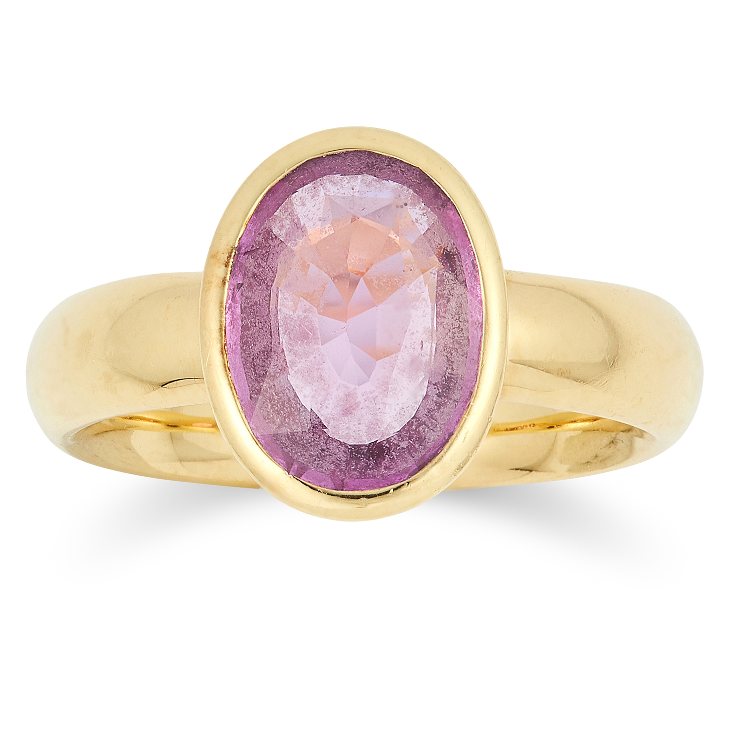 A PINK SAPPHIRE RING set with an oval cut pink sapphire, on later George Jensen band, size L / 5.